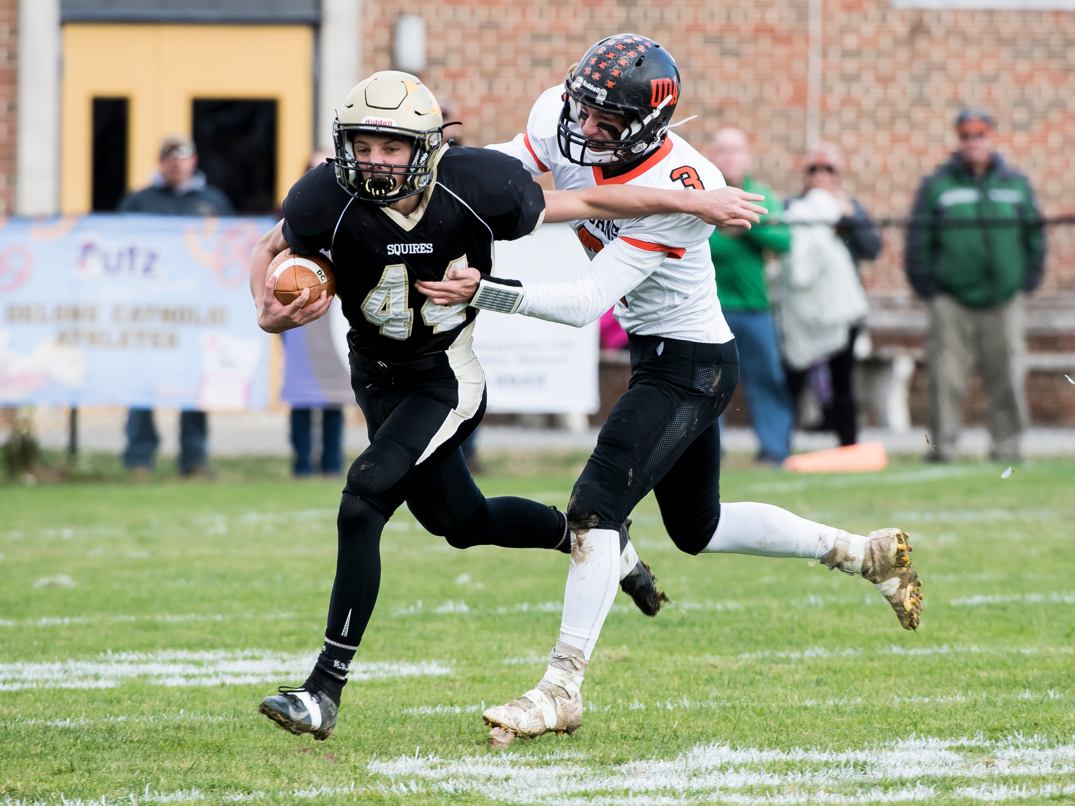 Delone Catholic's AJ Knobloch runs the ball against Upper Dauphin during a District III Class 2A semifinal game on Saturday, November 3, 2018. The Squires won 48-23.