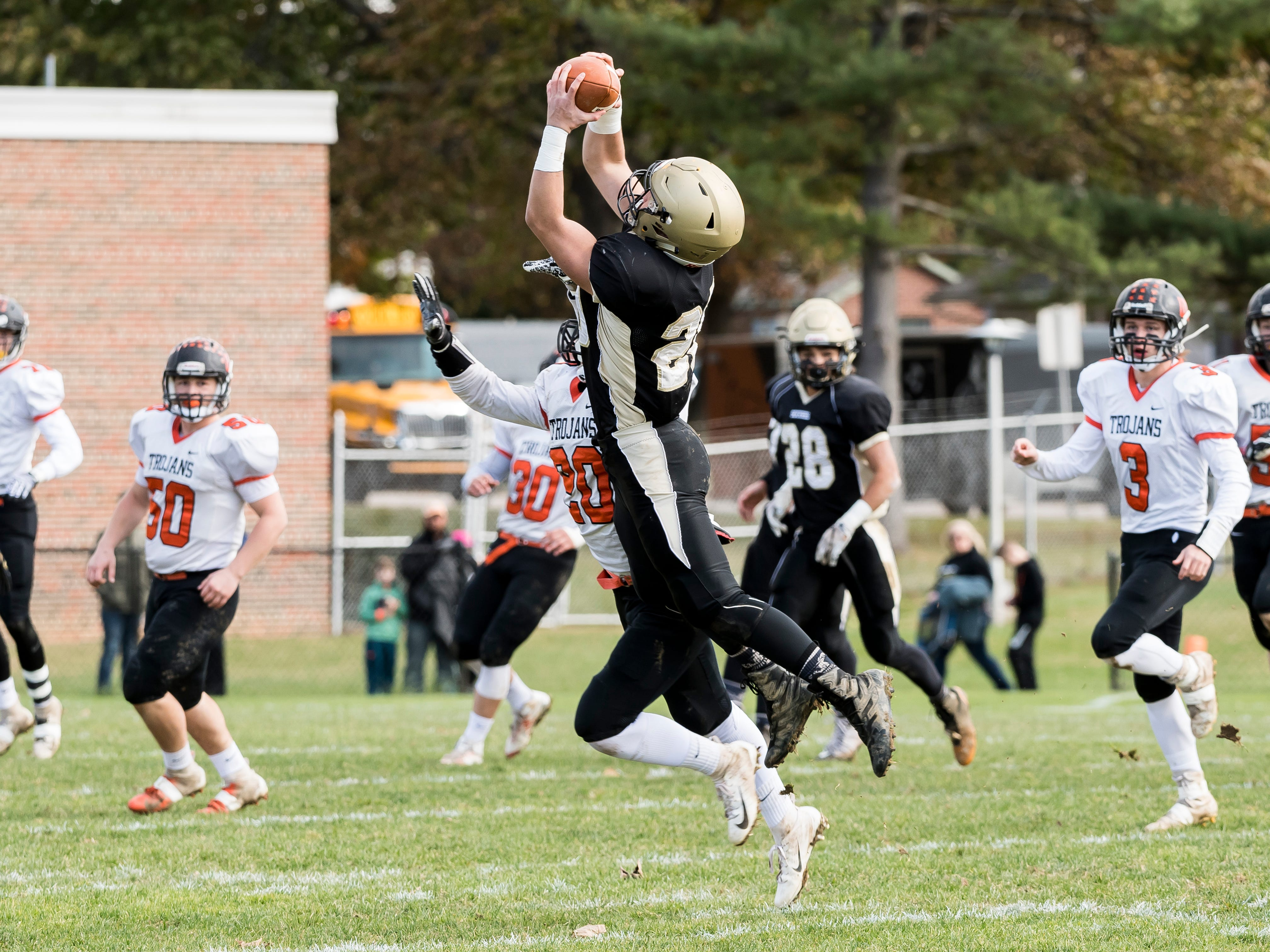 Delone Catholic's Tyler Monto makes a catch in the middle of the field during a District III Class 2A semifinal game against Upper Dauphin on Saturday, November 3, 2018. The Squires won 48-23.