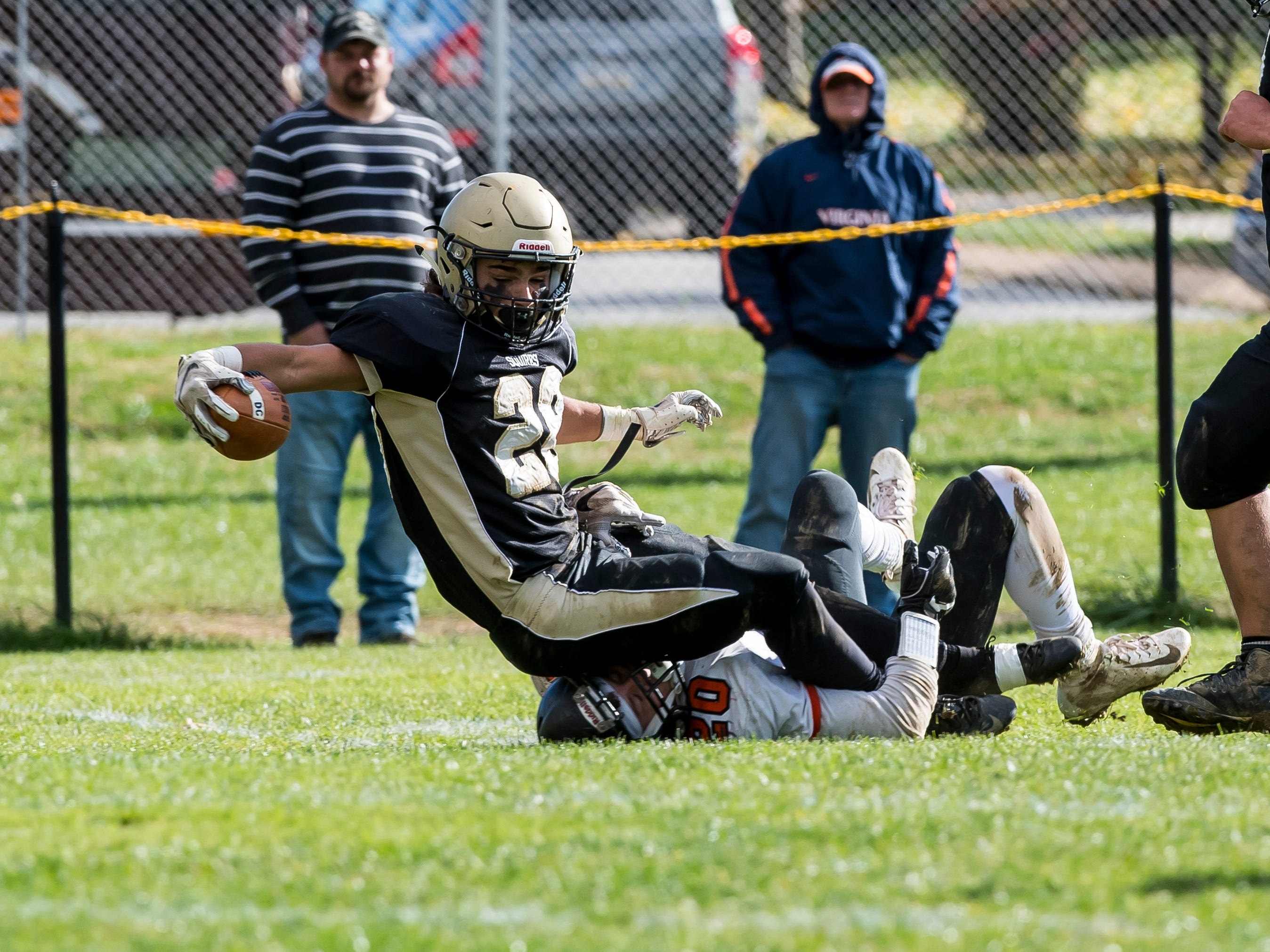 Delone Catholic's Joe Hernandez reaches out with the ball to cross the goal line and score a touchdown during a District III Class 2A semifinal game against Upper Dauphin on Saturday, November 3, 2018. The Squires won 48-23.