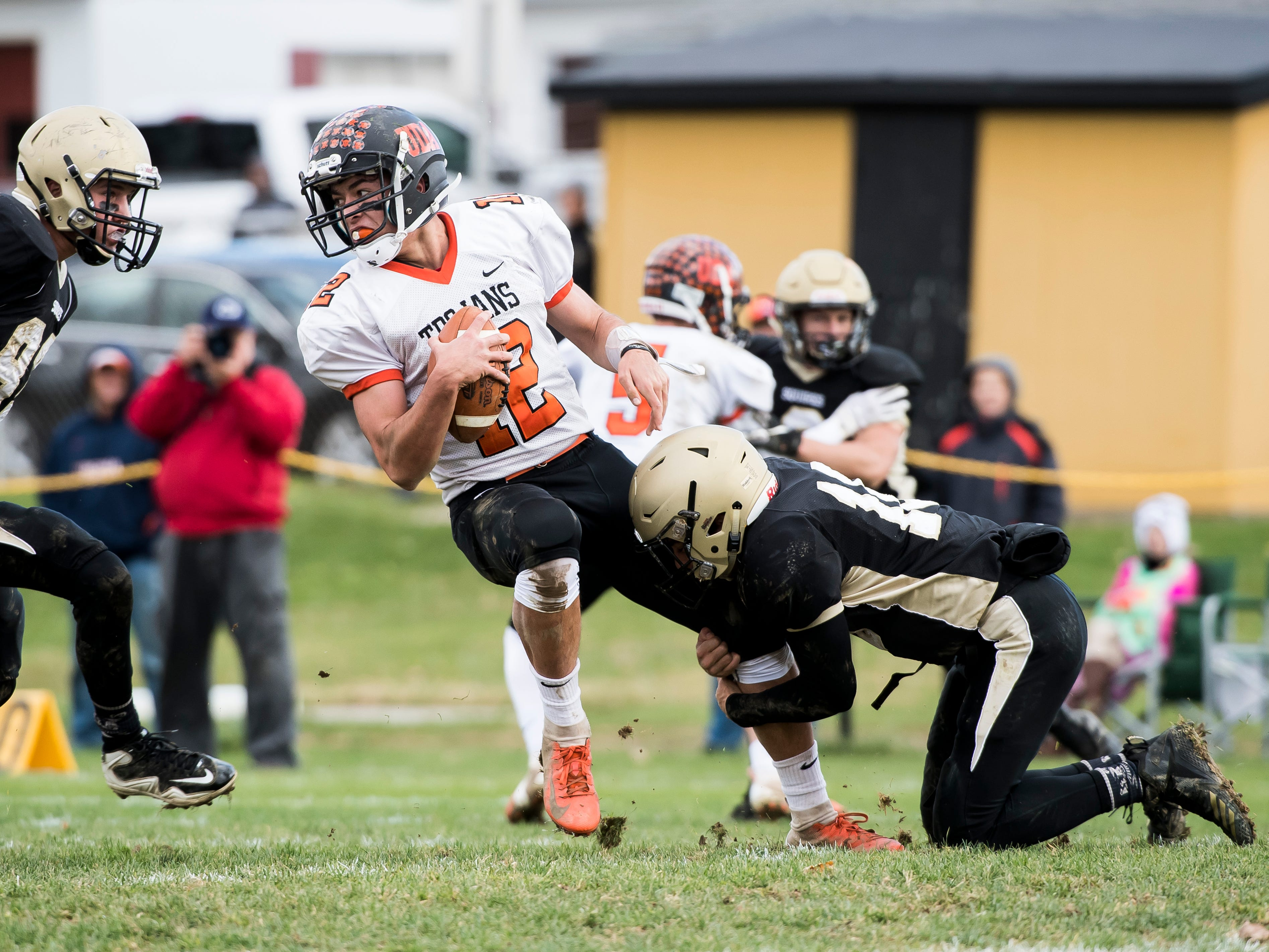 Delone Catholic's Evan Brady tackles Upper Dauphin's Macklin Ayers during a District III Class 2A semifinal game on Saturday, November 3, 2018. The Squires won 48-23.