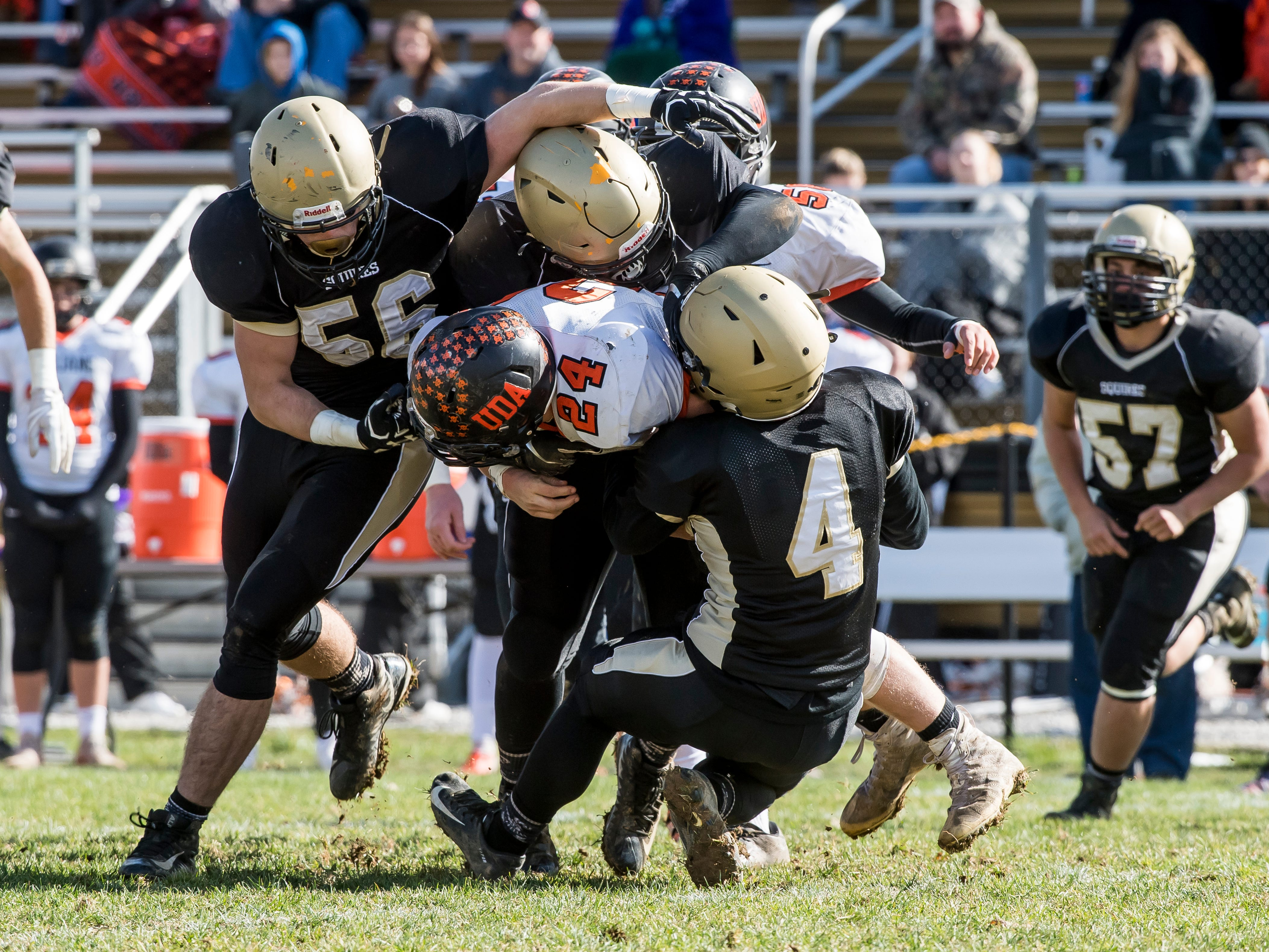 A host of Delone Catholic players tackle Upper Dauphin's Jake Ramberger during a District III Class 2A semifinal game on Saturday, November 3, 2018. The Squires won 48-23.