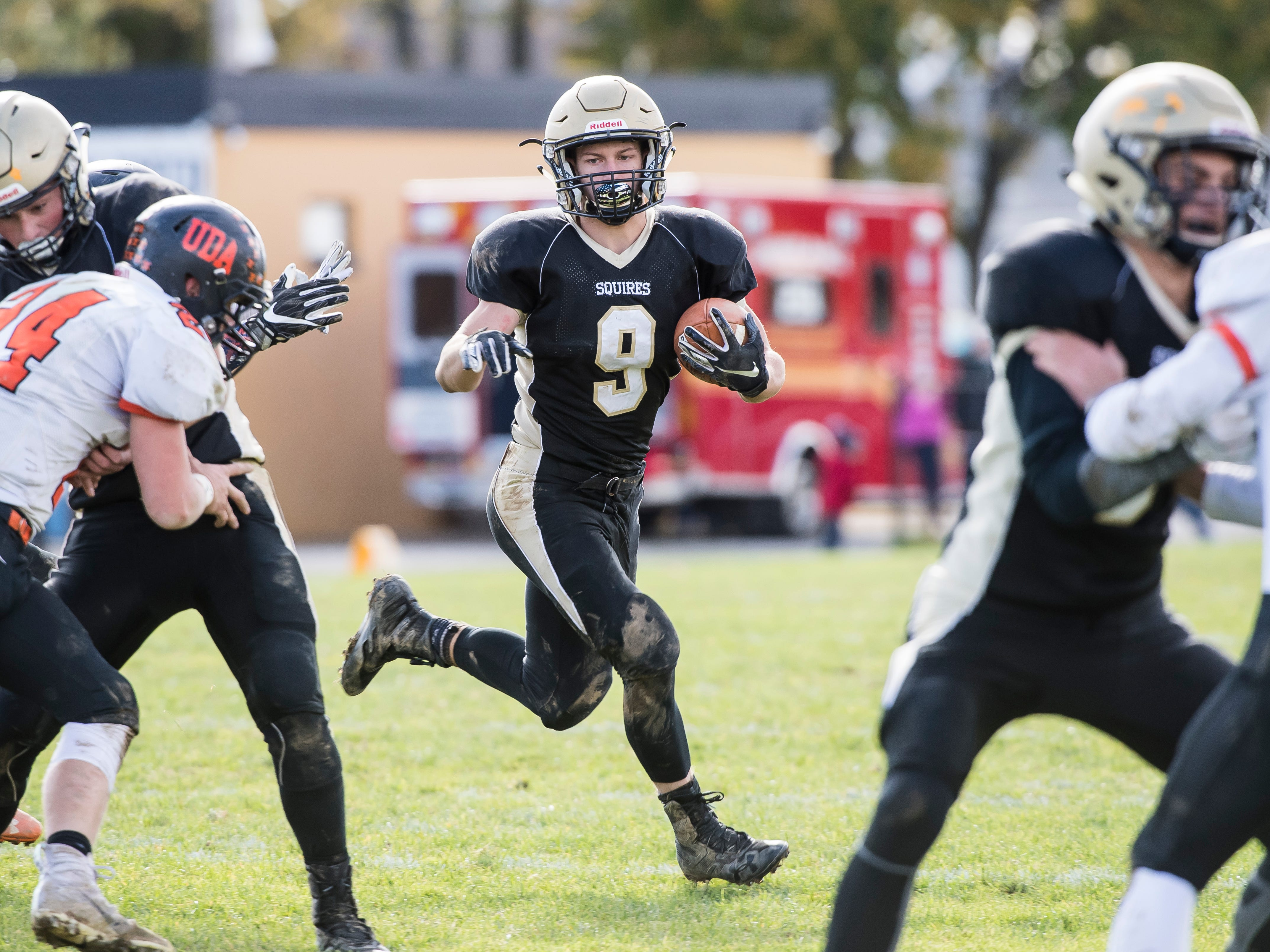 Delone Catholic's Logan Brown carries the ball against Upper Dauphin during a District III Class 2A semifinal game on Saturday, November 3, 2018. The Squires won 48-23.