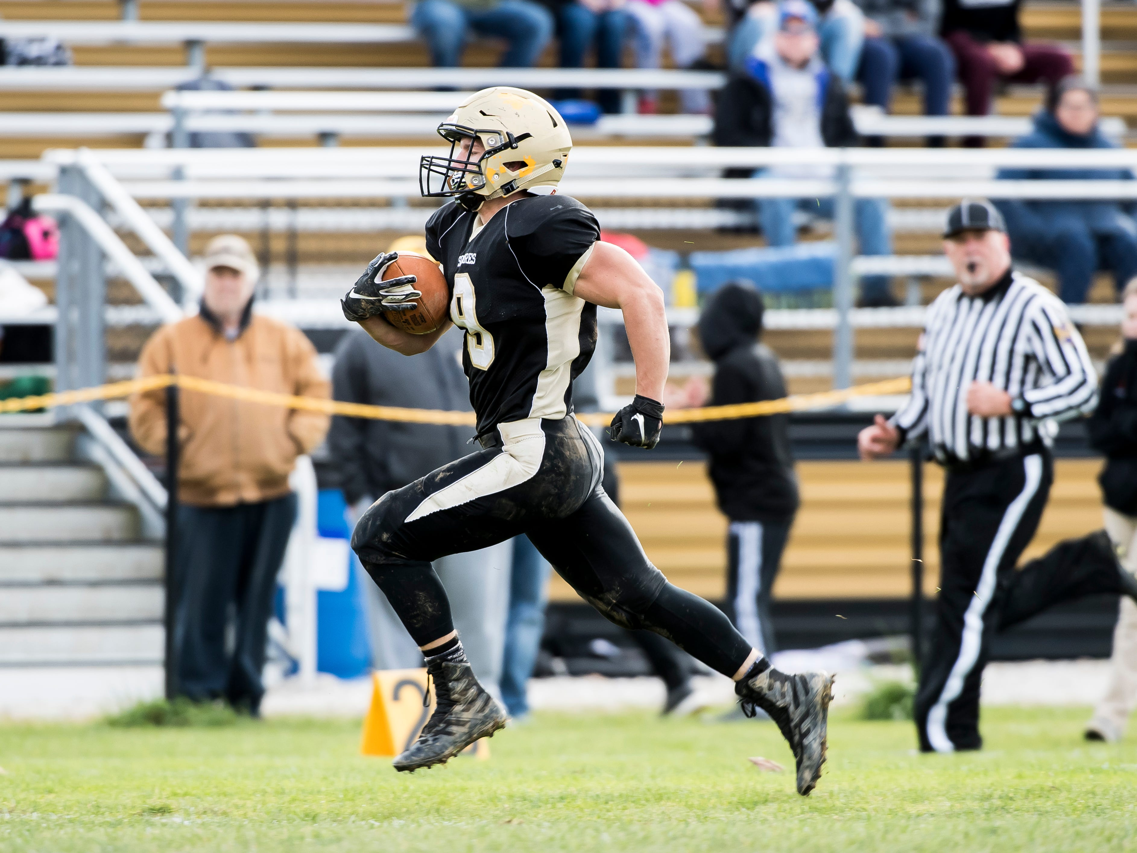Delone Catholic's Logan Brown takes off for the end zone during a District III Class 2A semifinal game against Upper Dauphin on Saturday, November 3, 2018. The Squires won 48-23.