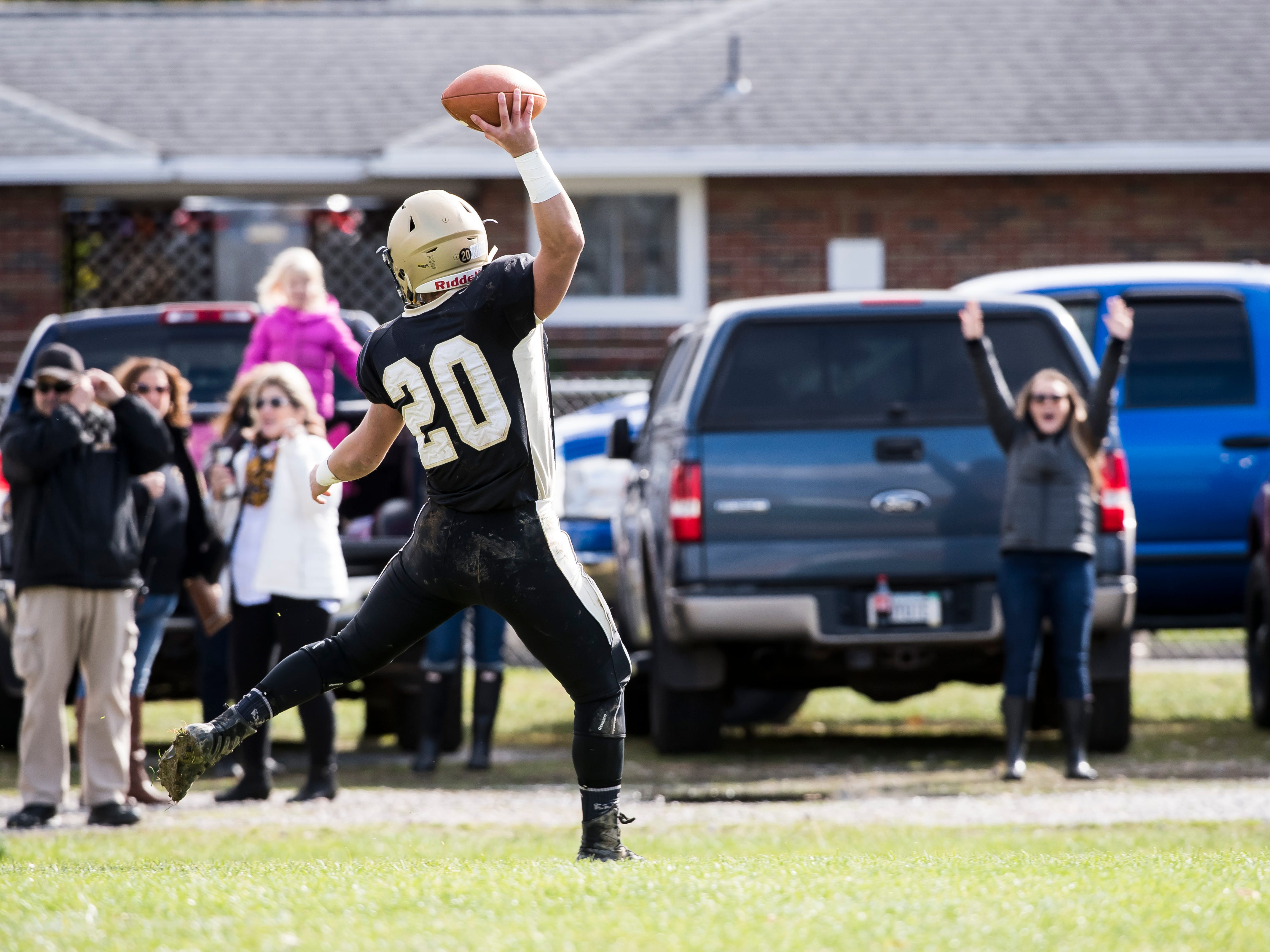 Delone Catholic's Tyler Monto celebrates in the end zone after scoring a touchdown in a District III Class 2A semifinal game against Upper Dauphin on Saturday, November 3, 2018. The Squires won 48-23.