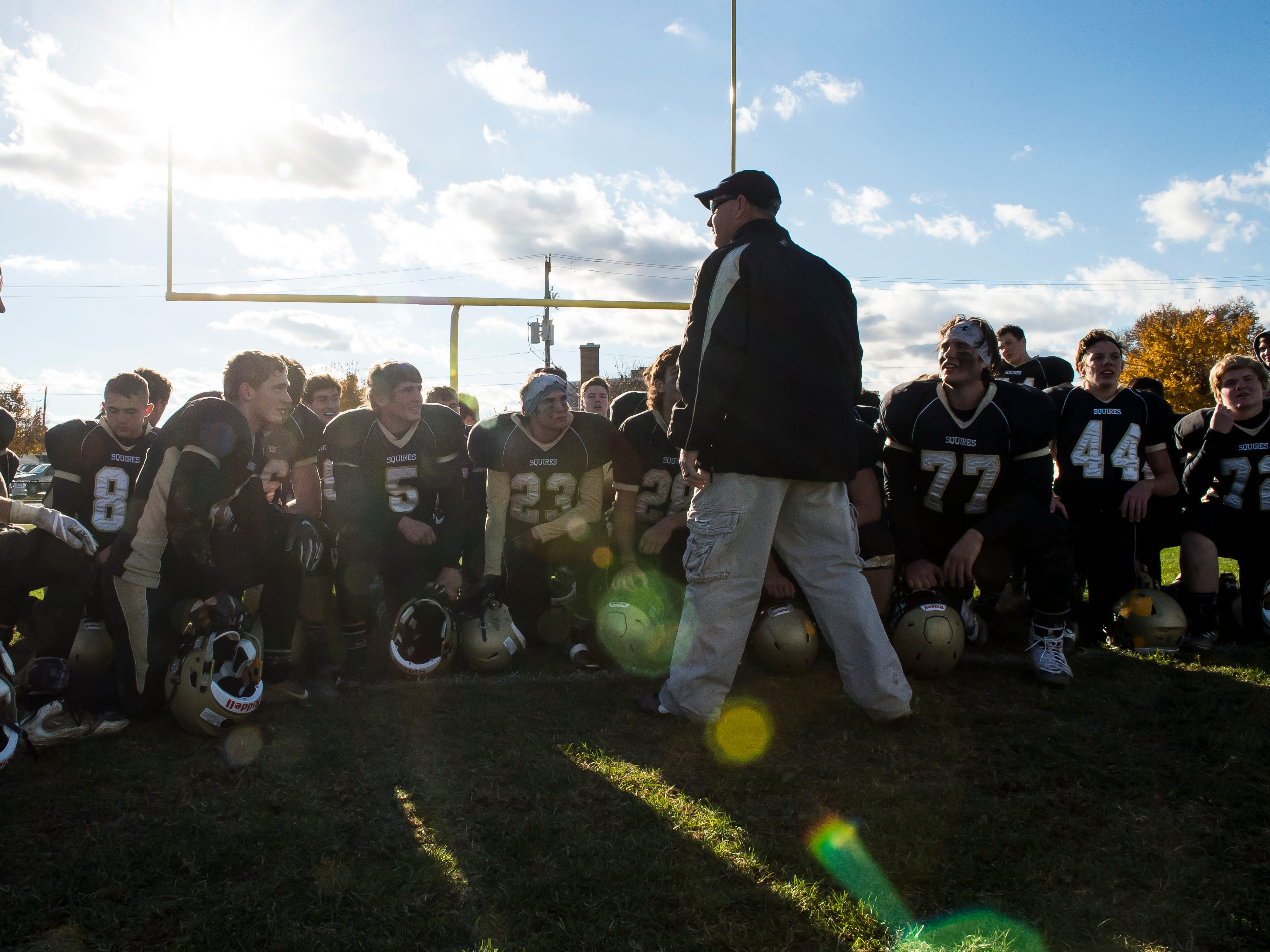 Delone Catholic players listen to one of their coaches following a 48-23 win over Upper Dauphin in a District III Class 2A semifinal game on Saturday, November 3, 2018. The Squires will play in the District title game against York Catholic on Friday.