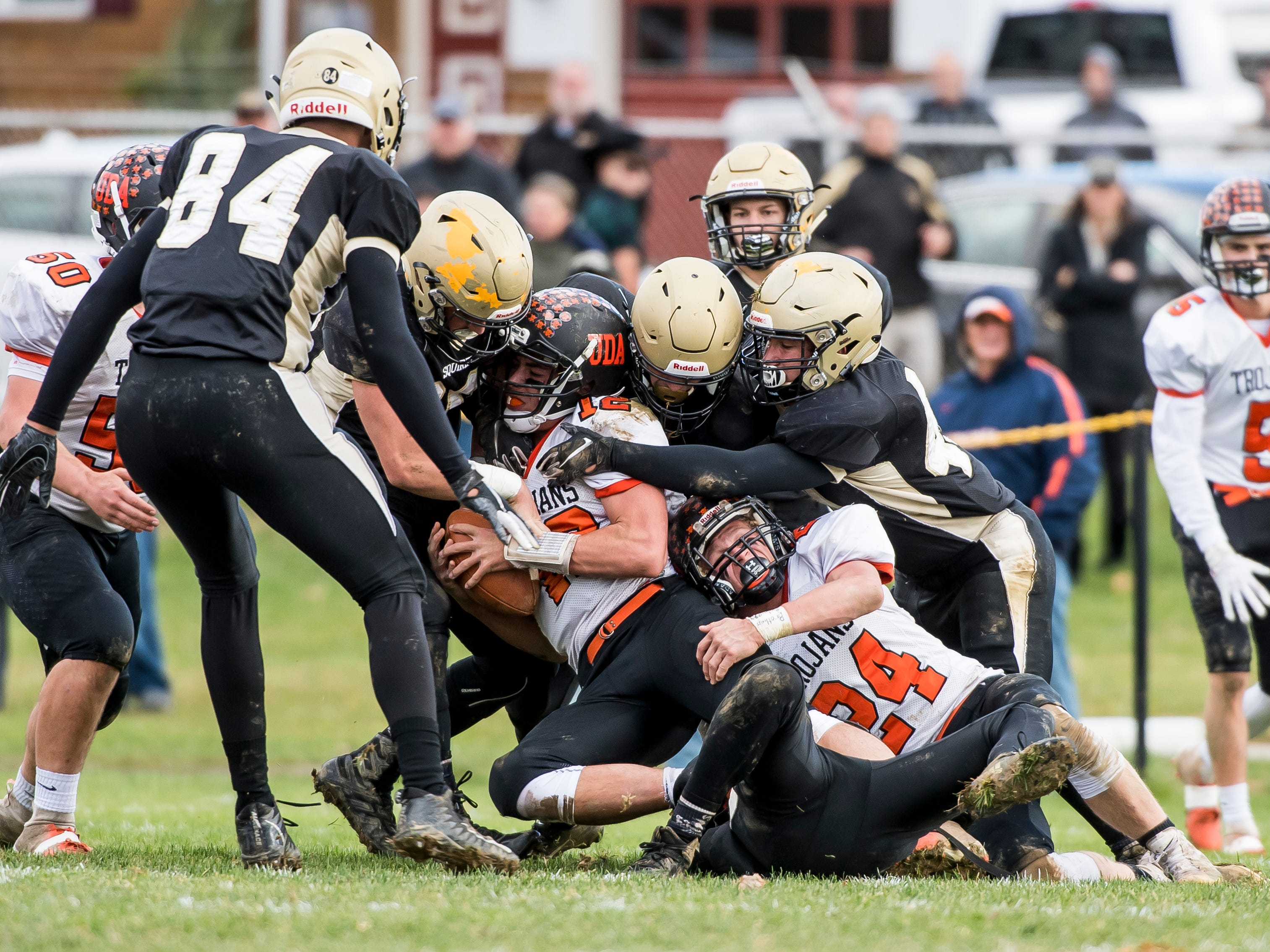 A host of Delone Catholic players put the hit on Upper Dauphin's Macklin Ayers during a District III Class 2A semifinal game on Saturday, November 3, 2018. The Squires won 48-23.