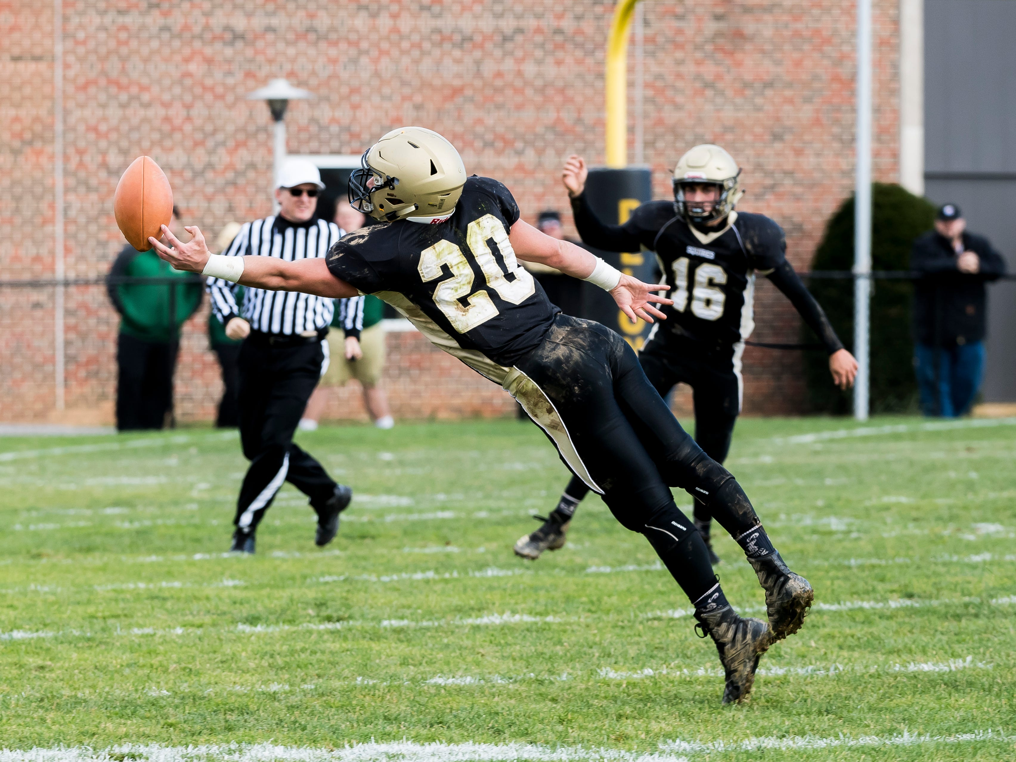 A pass intended for Delone Catholic's Tyler Monto is just out of reach during a District III Class 2A semifinal game against Upper Dauphin on Saturday, November 3, 2018. The Squires won 48-23.