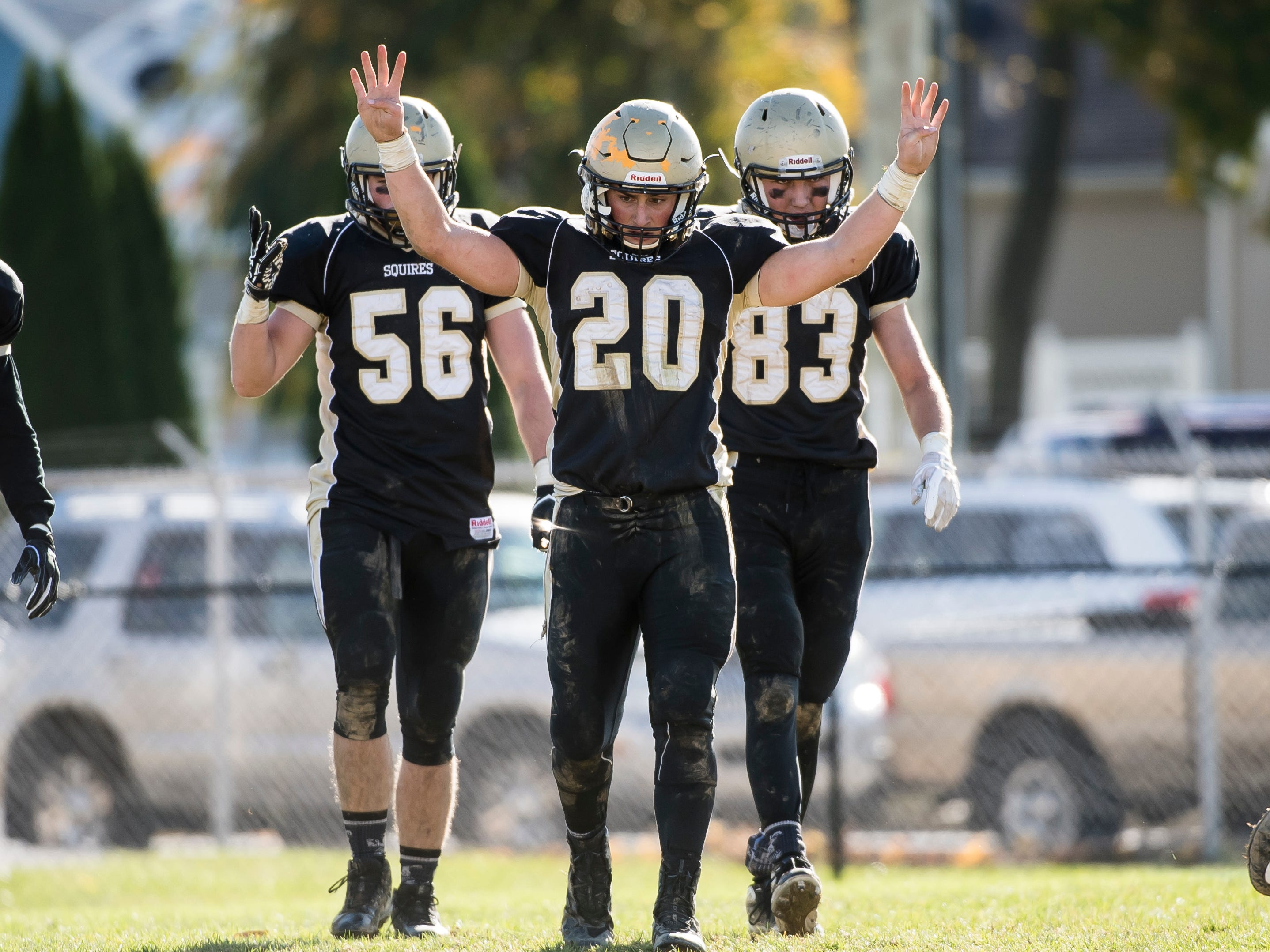 Delone Catholic's Tyler Monto (20) holds up four fingers to signify the start of the fourth quarter during a District III Class 2A semifinal game against Upper Dauphin on Saturday, November 3, 2018. The Squires won 48-23.
