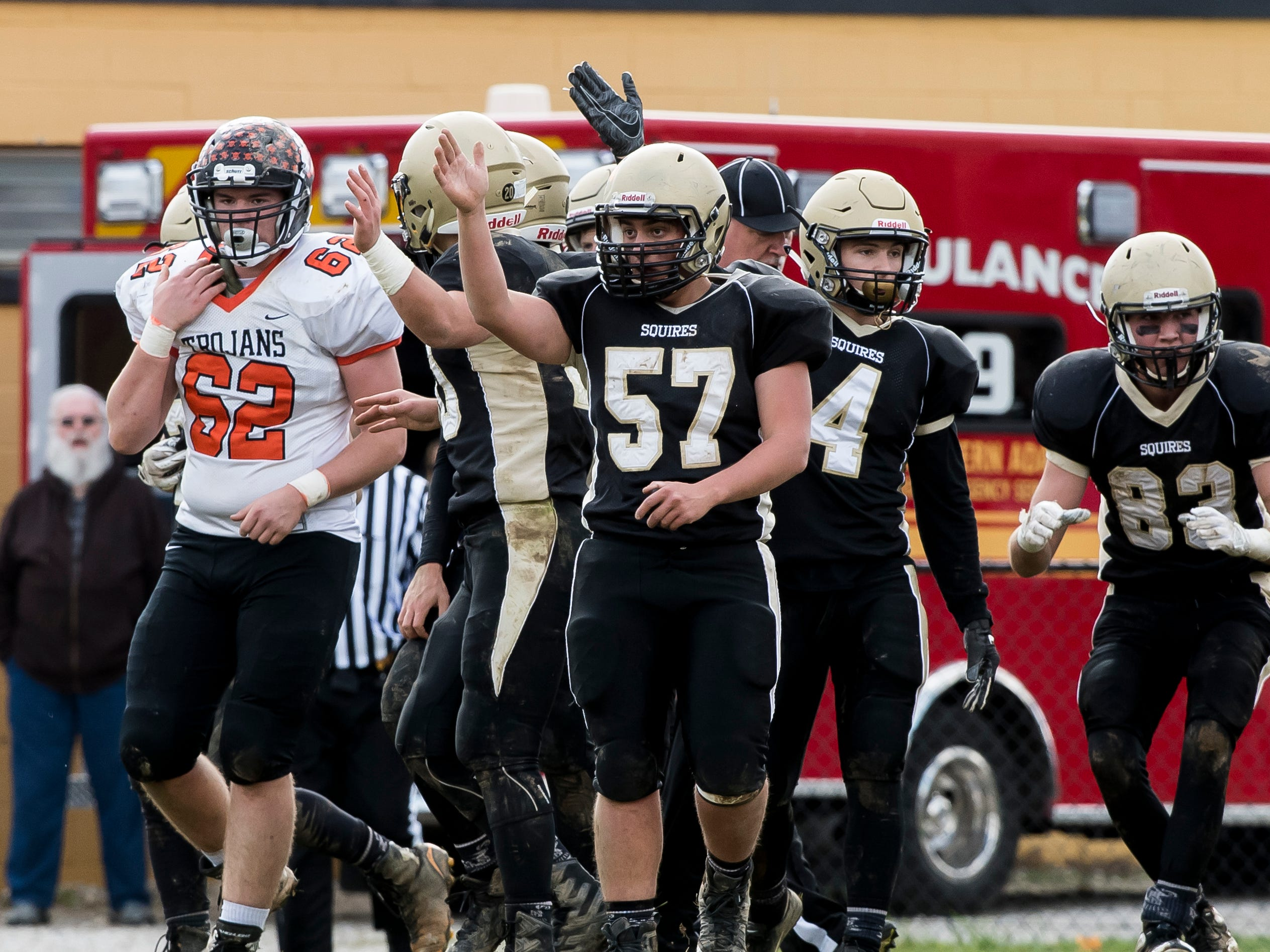 Delone Catholic's Bryce Leonard (57) and Colin Gebhart (4) react after recovering an Upper Dauphin fumble during a District III Class 2A semifinal game on Saturday, November 3, 2018. The Squires won 48-23.
