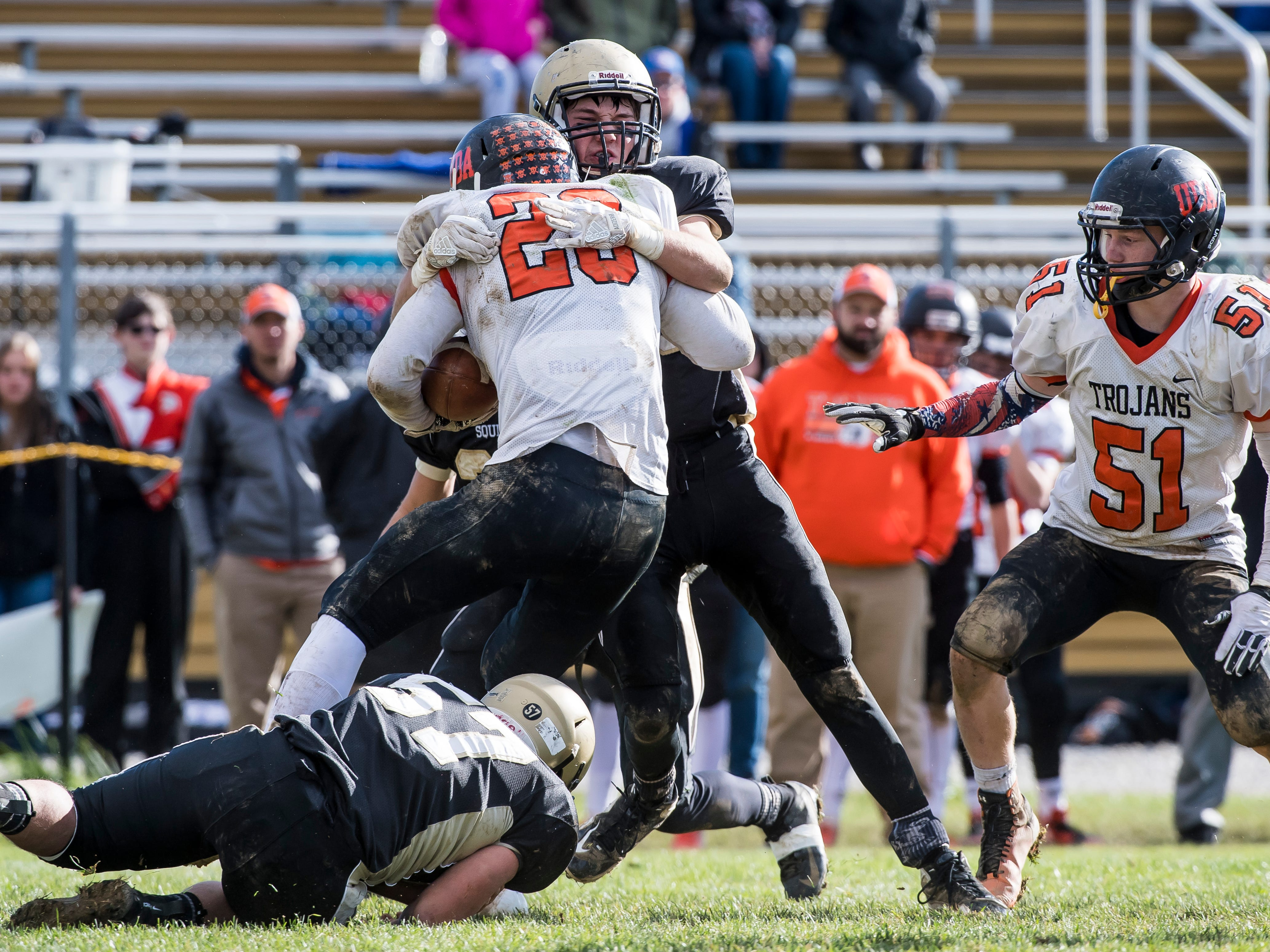 Upper Dauphin's Mason Wiest is tackled by a Delone Catholic defender during a District III Class 2A semifinal game on Saturday, November 3, 2018. The Squires won 48-23.