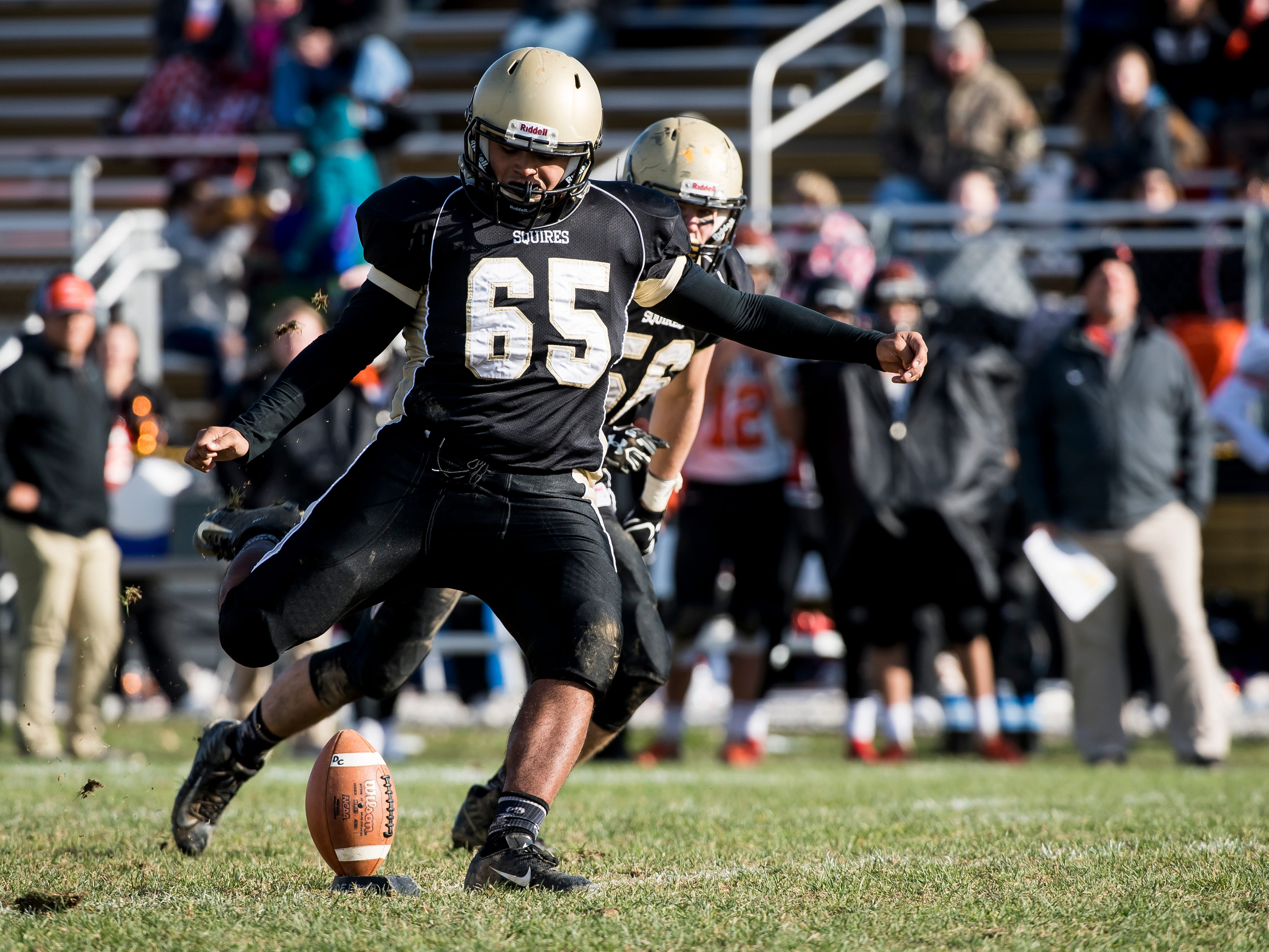 Delone Catholic's Tony Espinoza kicks off to Upper Dauphin during a District III Class 2A semifinal game on Saturday, November 3, 2018. The Squires won 48-23.