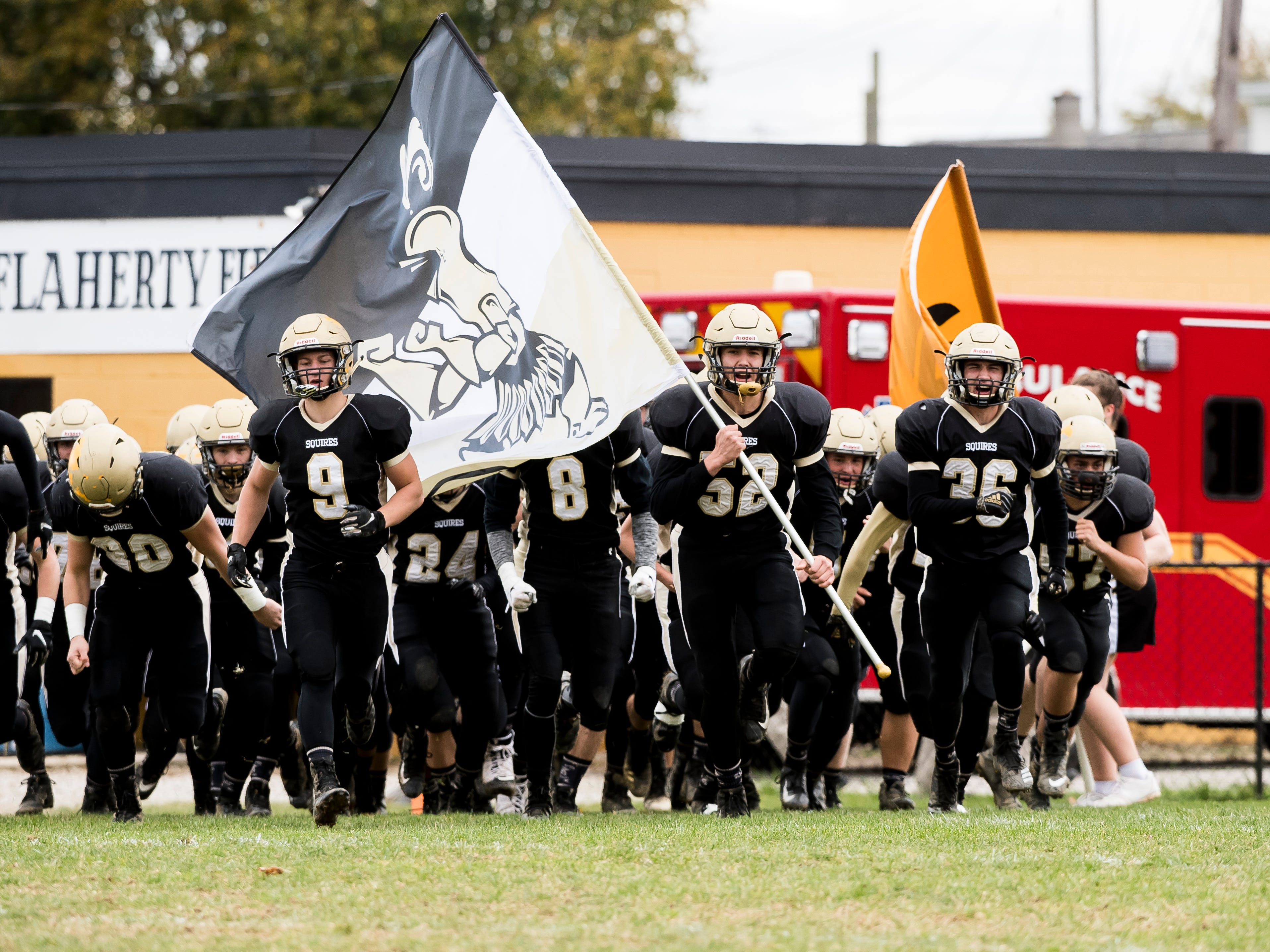 Delone Catholic's Andrew Shipley (52) leads the Squires onto J.T. Flaherty Field before a District III Class 2A semifinal game against Upper Dauphin on Saturday, November 3, 2018. The Squires won 48-23.