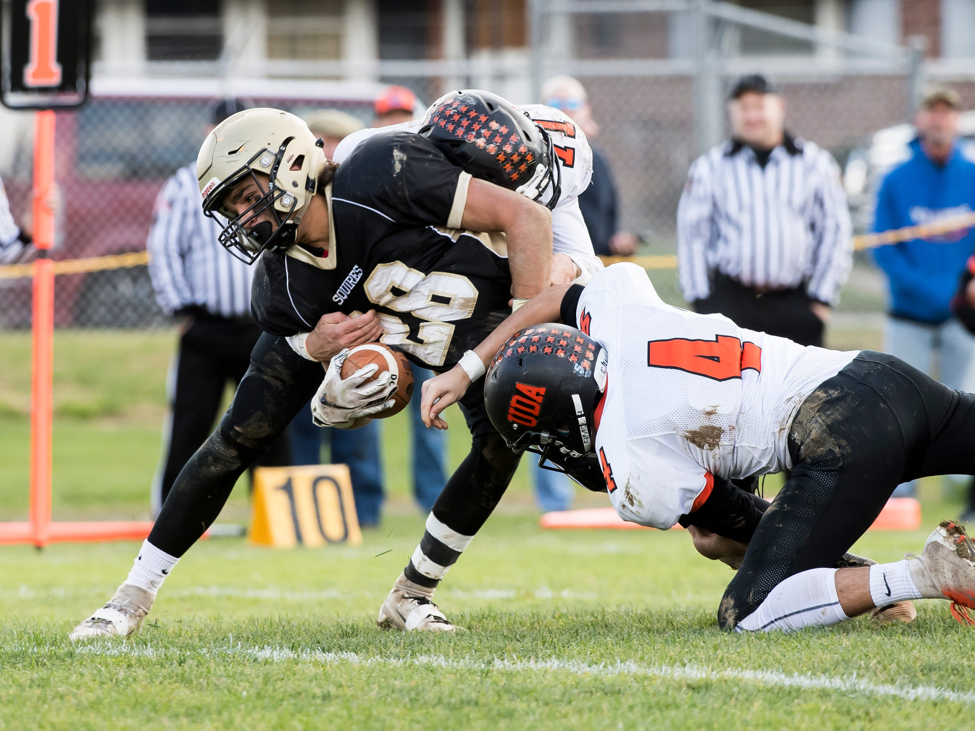Delone Catholic's Joe Hernandez is tackled inches from the end zone while carrying the ball against Upper Dauphin during a District III Class 2A semifinal game on Saturday, November 3, 2018. The Squires would score on the next play and won the game 48-23.