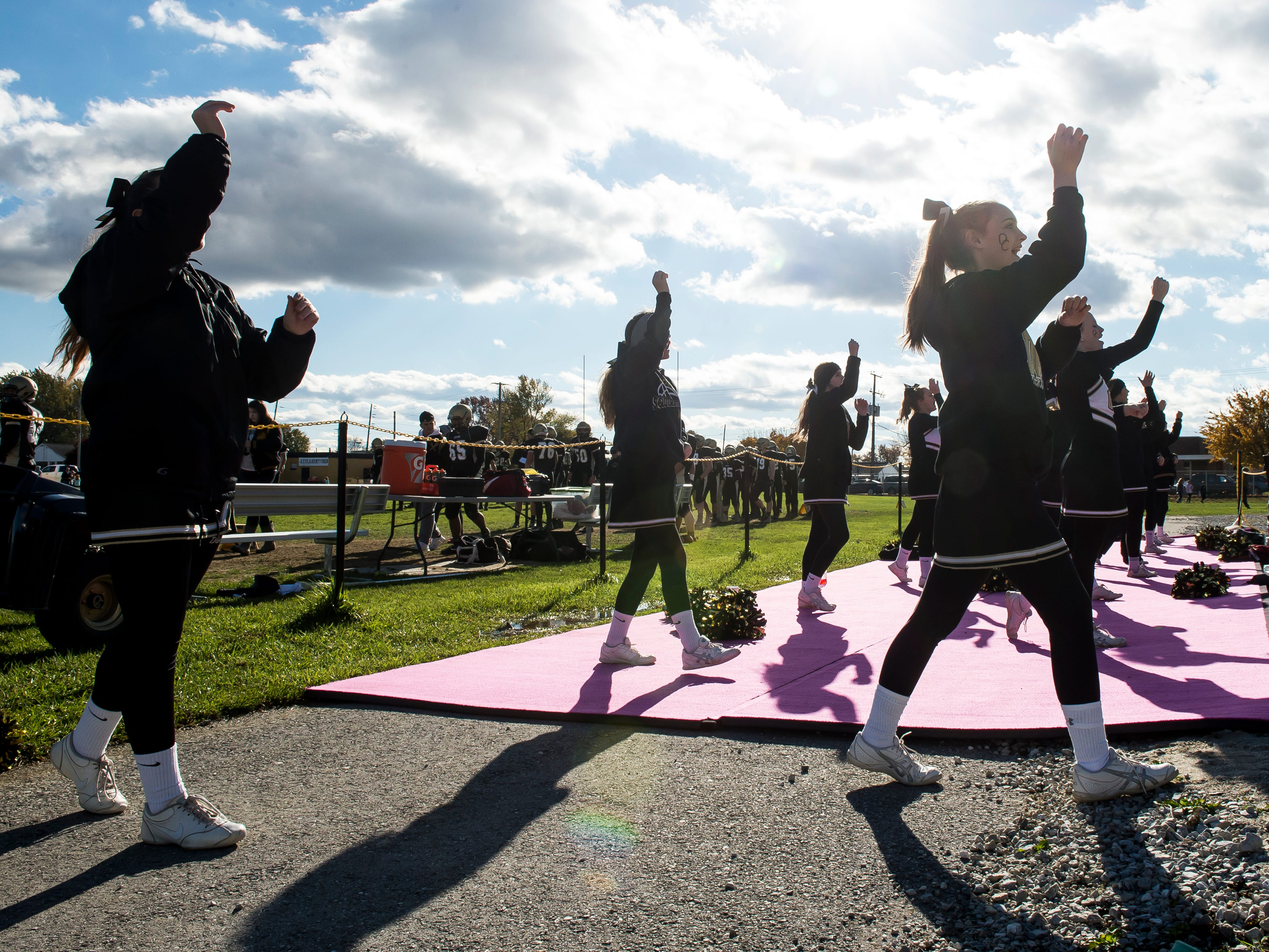 Delone Catholic cheerleaders perform a routine during a District III Class 2A semifinal game on Saturday, November 3, 2018.