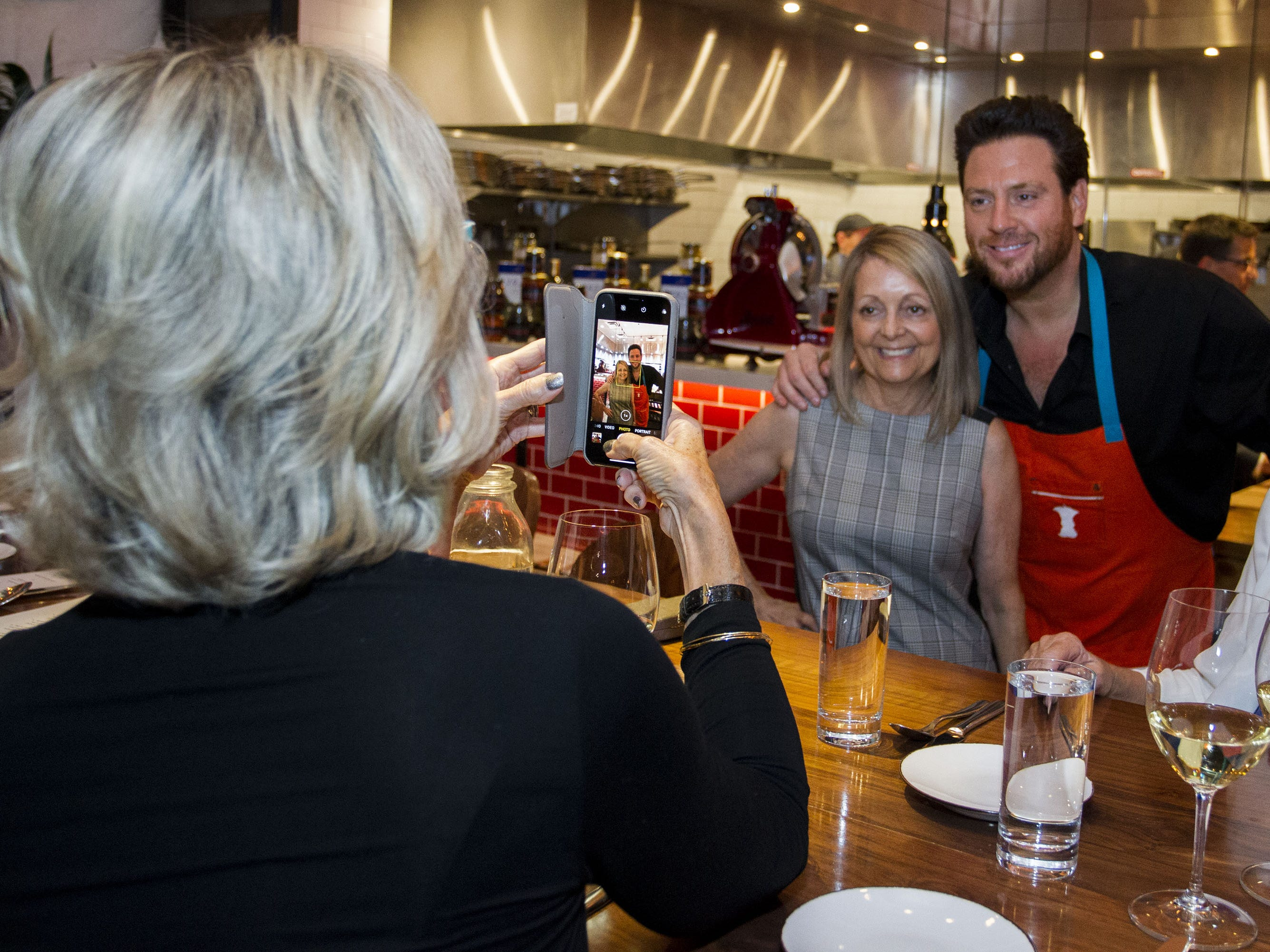 Chef Scott Conant poses with Ronna Glick during the exclusive kickoff dining event at Mora Italian for azcentral Wine & Food Experience.