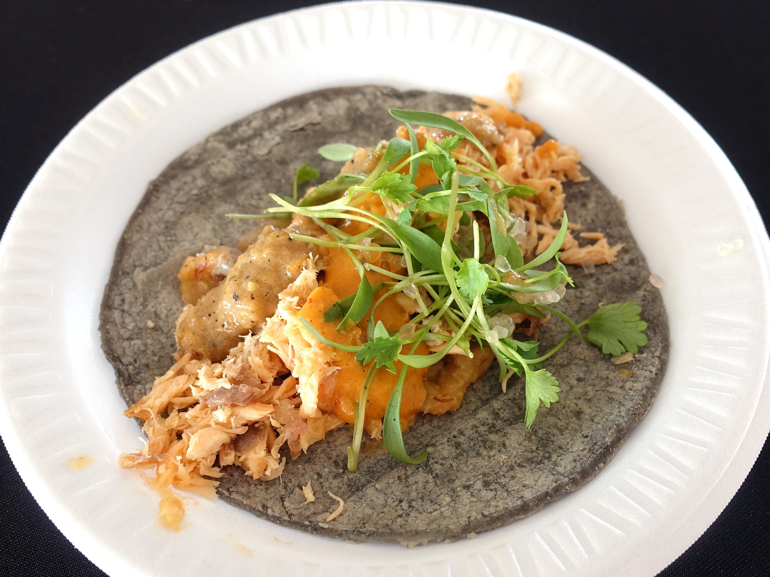 Salmon machaca taco with cashew crema, lemon caviar, micro cilantro and grilled chile guero salsa from Boca Tacos  y Tequila at azcentral Wine & Food Experience at WestWorld of Scottsdale Saturday, Nov. 3, 2018.