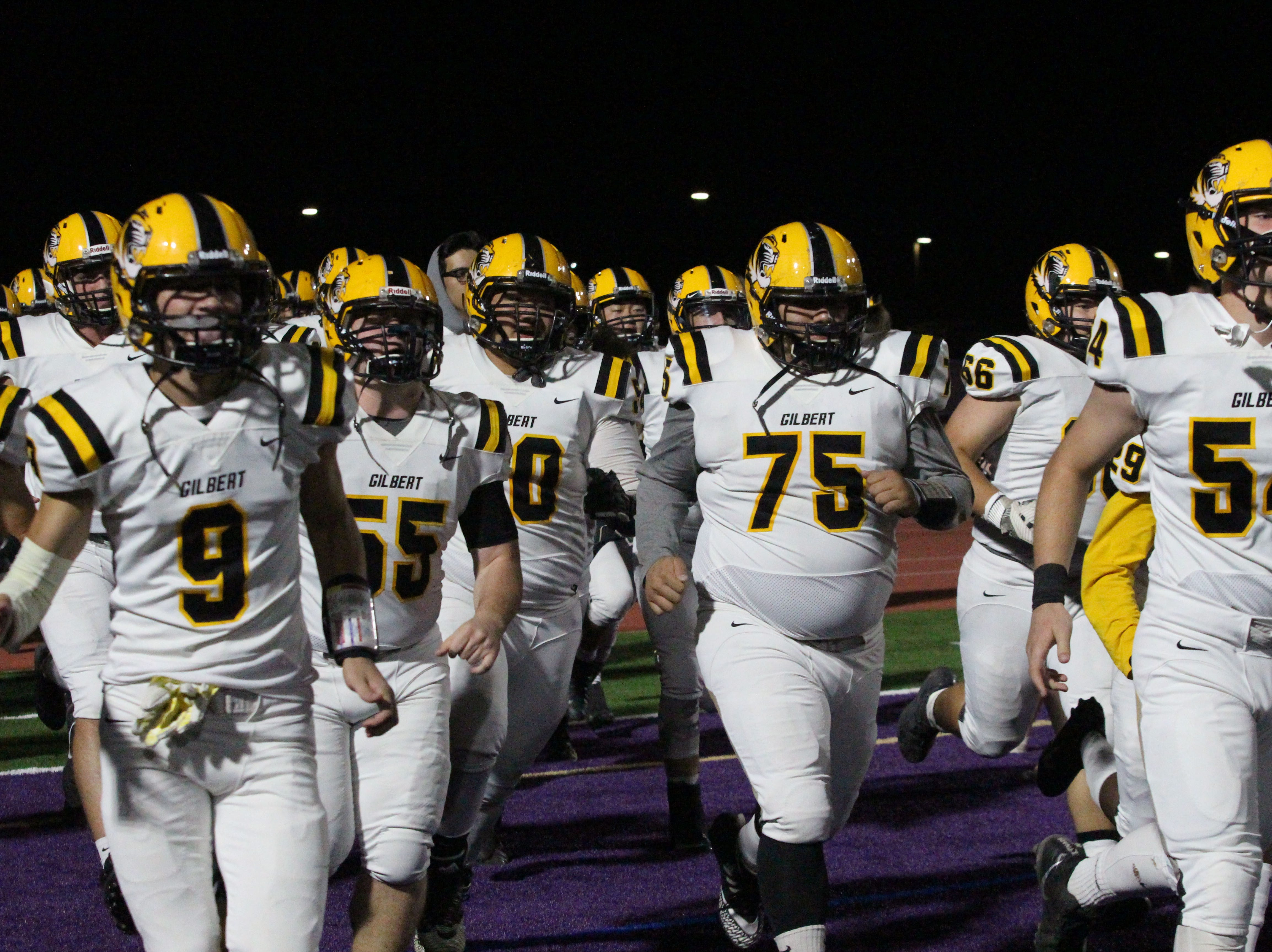 Gilbert runs onto the field before the Tigers' game against Notre Dame on Friday night at Notre Dame Preparatory High School on Nov. 2, 2018.