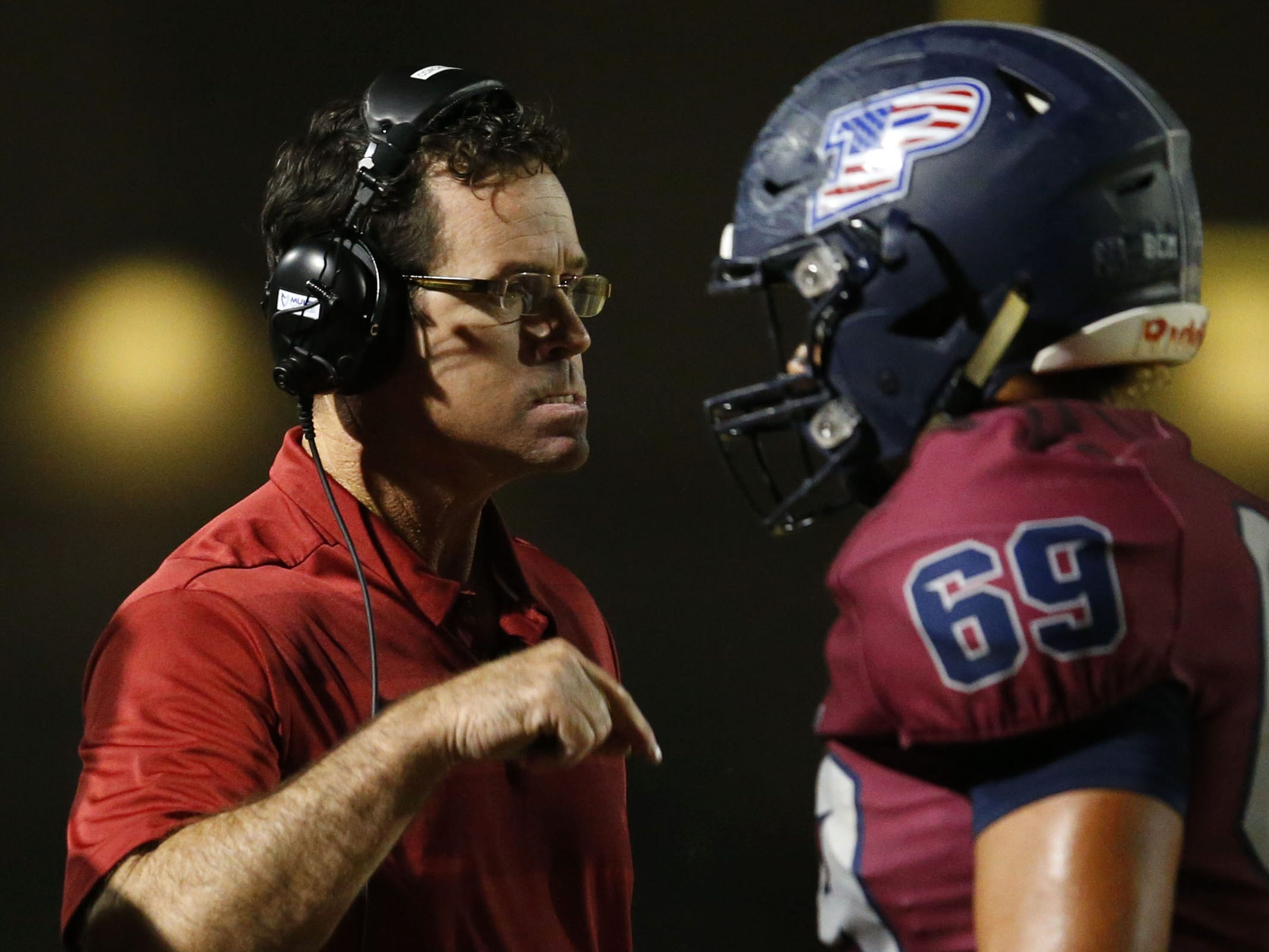 Perry head coach Preston Jones talks with Perry Hezekiah Lockhart (69) during a football game against Basha at Perry High School on November 2. #azhsfb
