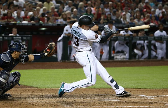 Diamondbacks shortstop Nick Ahmed hits a three-run double against the Braves at Chase Field in September.