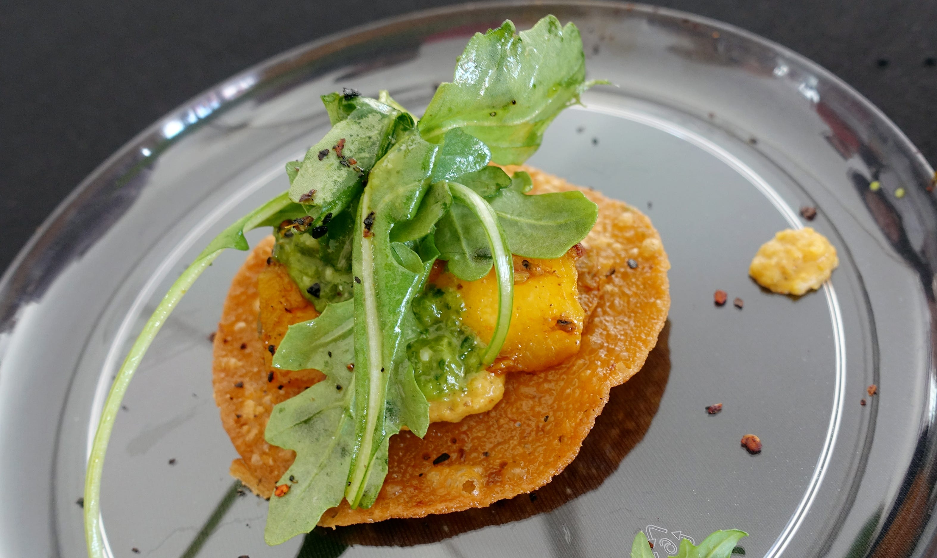 """Hatch chile """"crepe-stada"""" with barbecued acorn squash, Somali spiced creamed butternut, arugula and pesto from Crepe Bar at azcentral Wine & Food Experience 2018."""