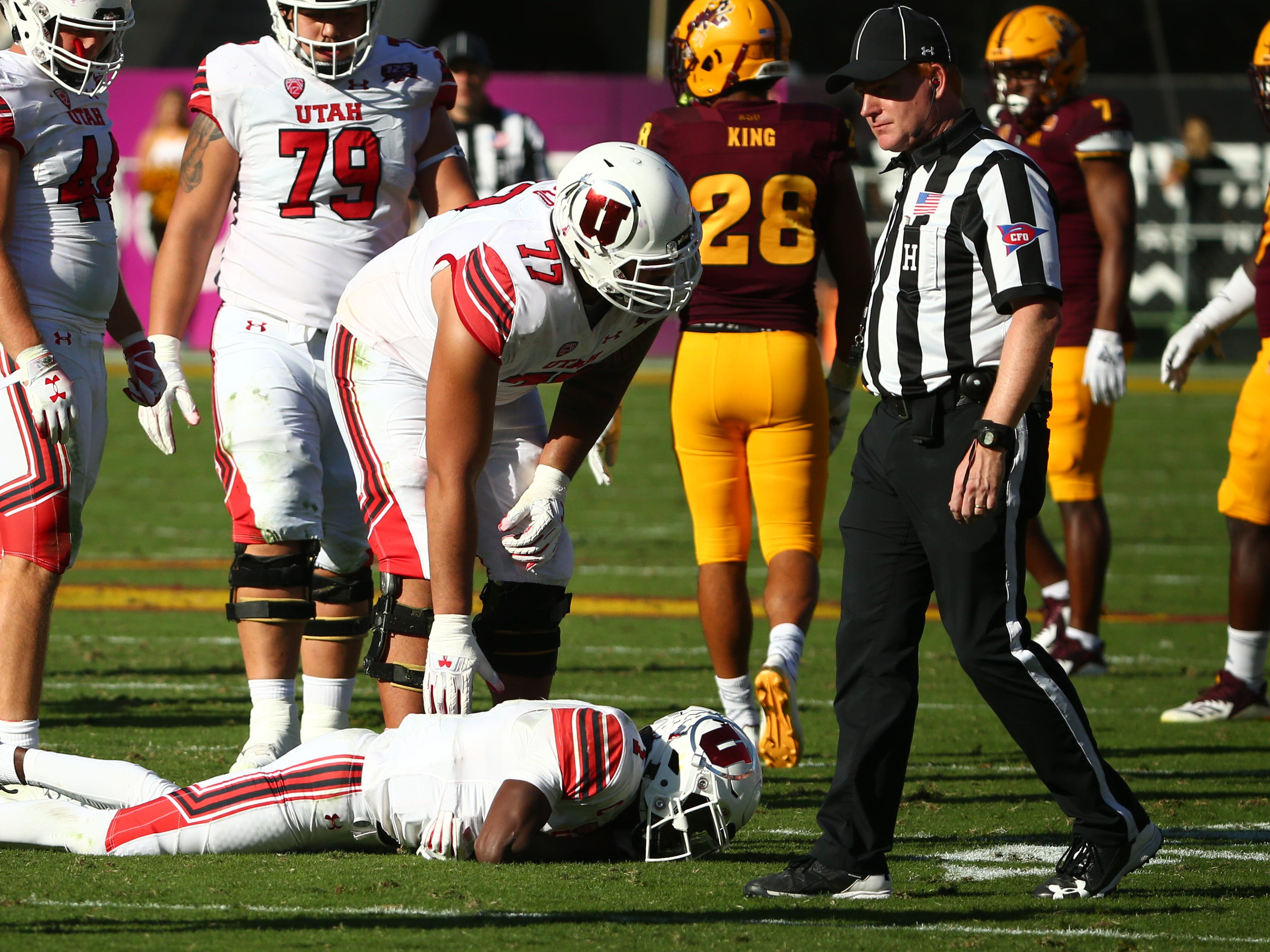 Utah quarterback Tyler Huntley leaves the after a shoulder injury against Arizona State in the second half on Nov. 3 at Sun Devil Stadium.