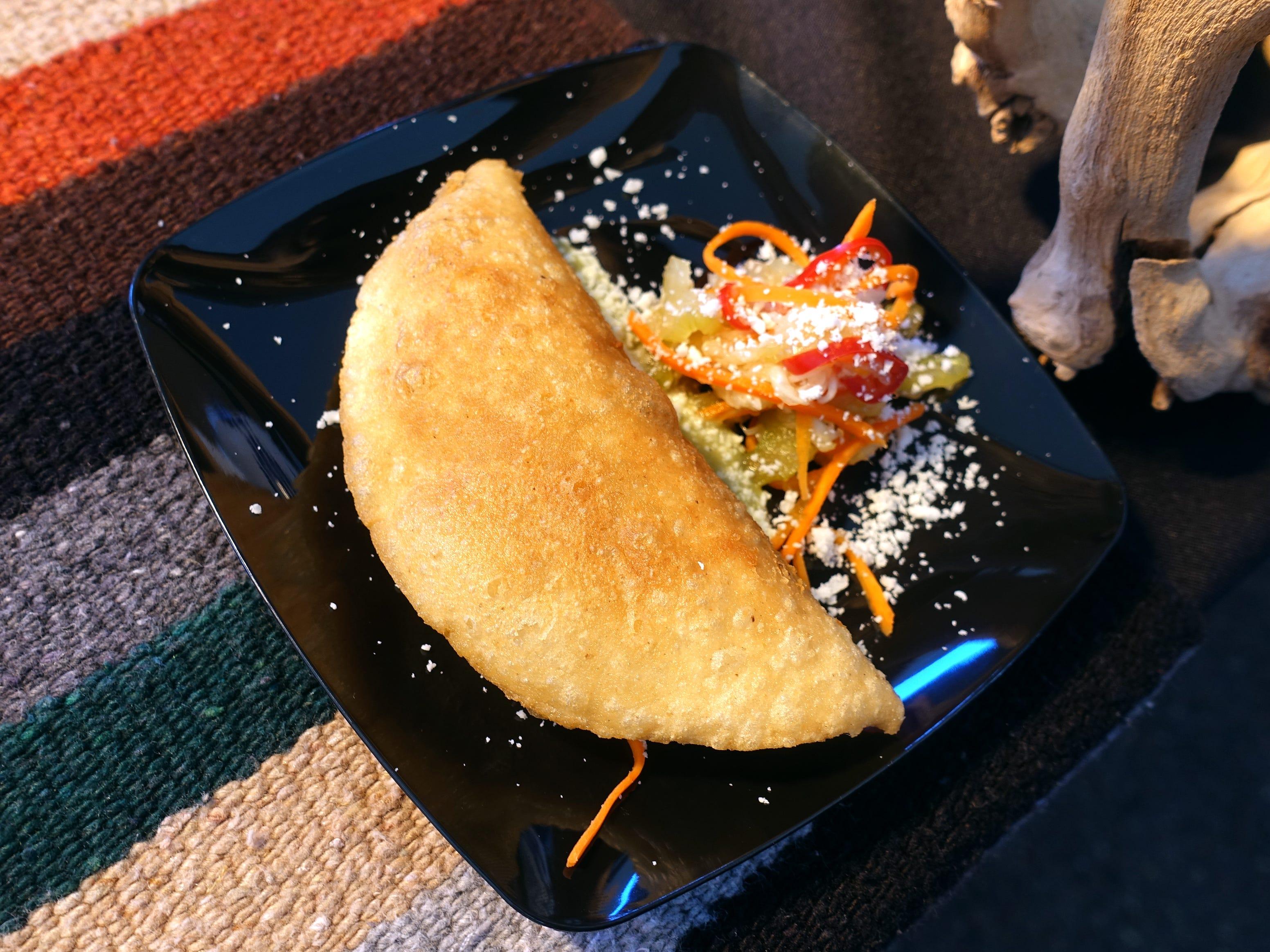 Chicken tinga chorizo quesadilla with crema fresca, salsa verde, escabeche and cotija cheese from La Hacienda at azcentral Wine & Food Experience 2018 at WestWorld of Scottsdale, Saturday, Nov. 3, 2018.