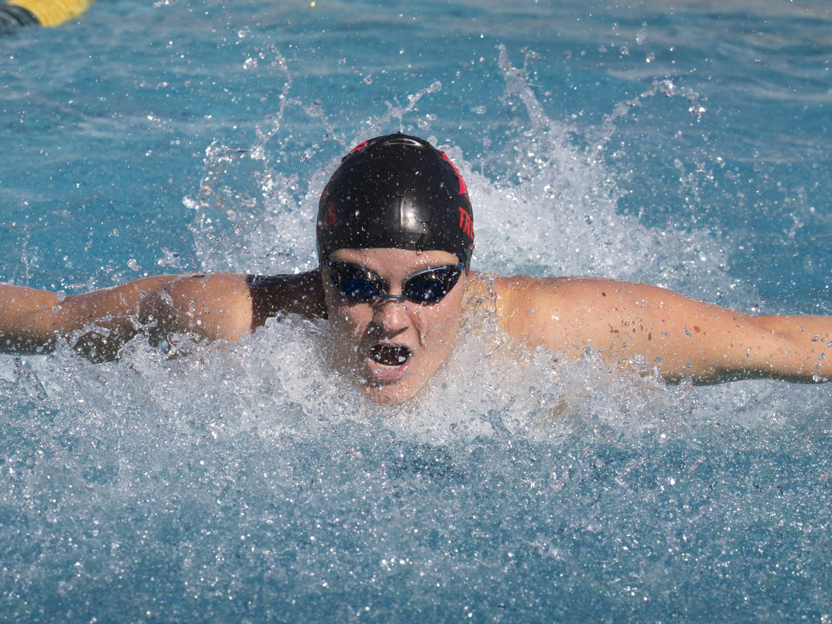Sadie Edwards (Paradise Valley) swims the 100 Butterfly, November 3, 2018, during the AIA Division II state swimming finals at the Skyline Aquatic Center, Mesa. Edwards won the event.