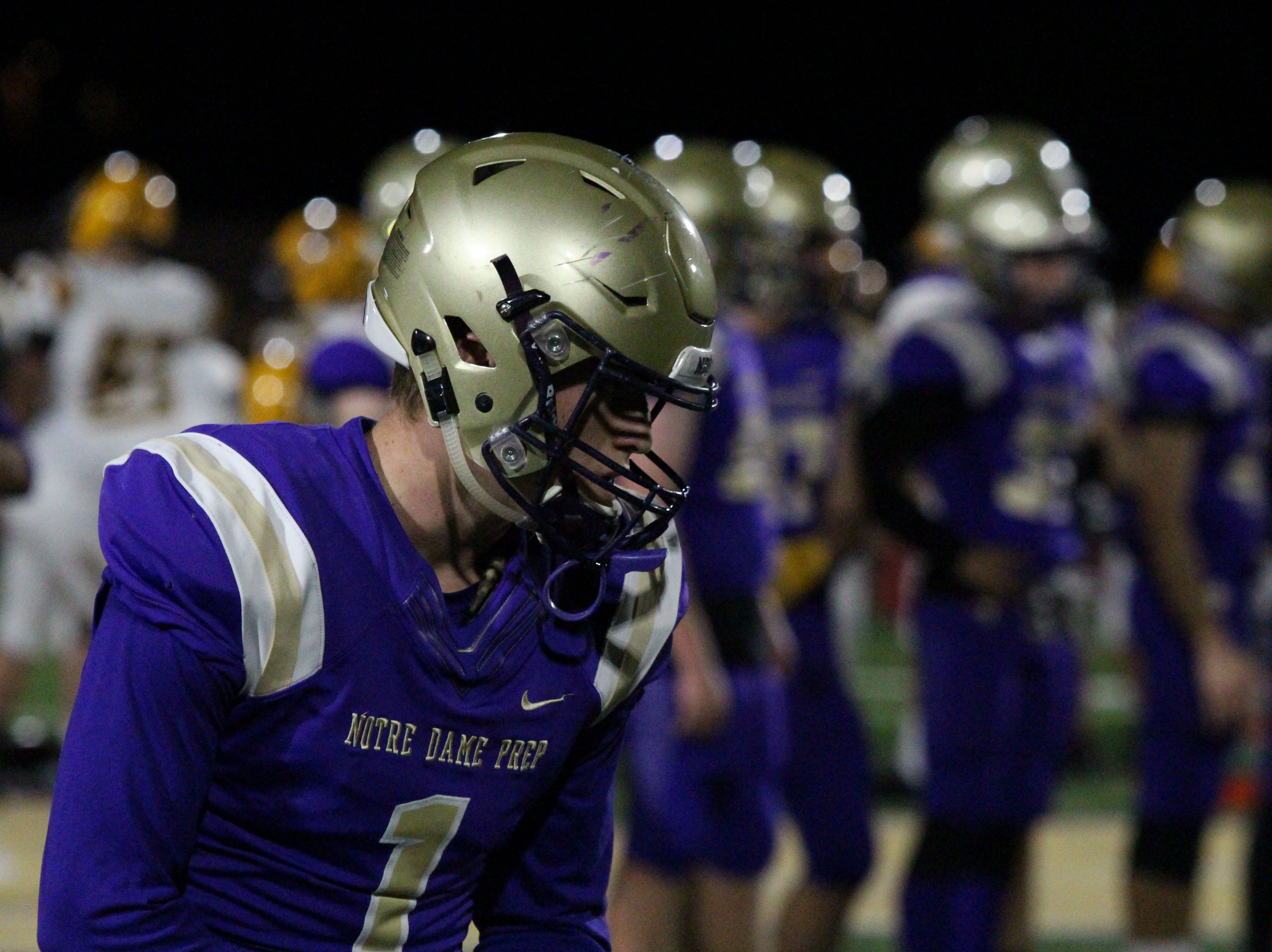 Notre Dame's Jake Smith lines up on the line before the Saint's game against Gilbert on Friday night at Notre Dame Preparatory High School on Nov. 2, 2018.