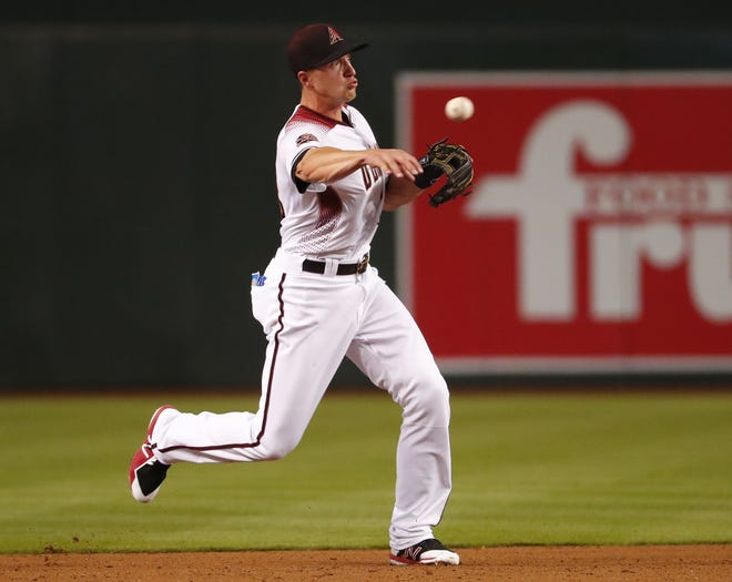 Diamondbacks shortstop Nick Ahmed throws out a Giants baserunner at Chase Field in April.