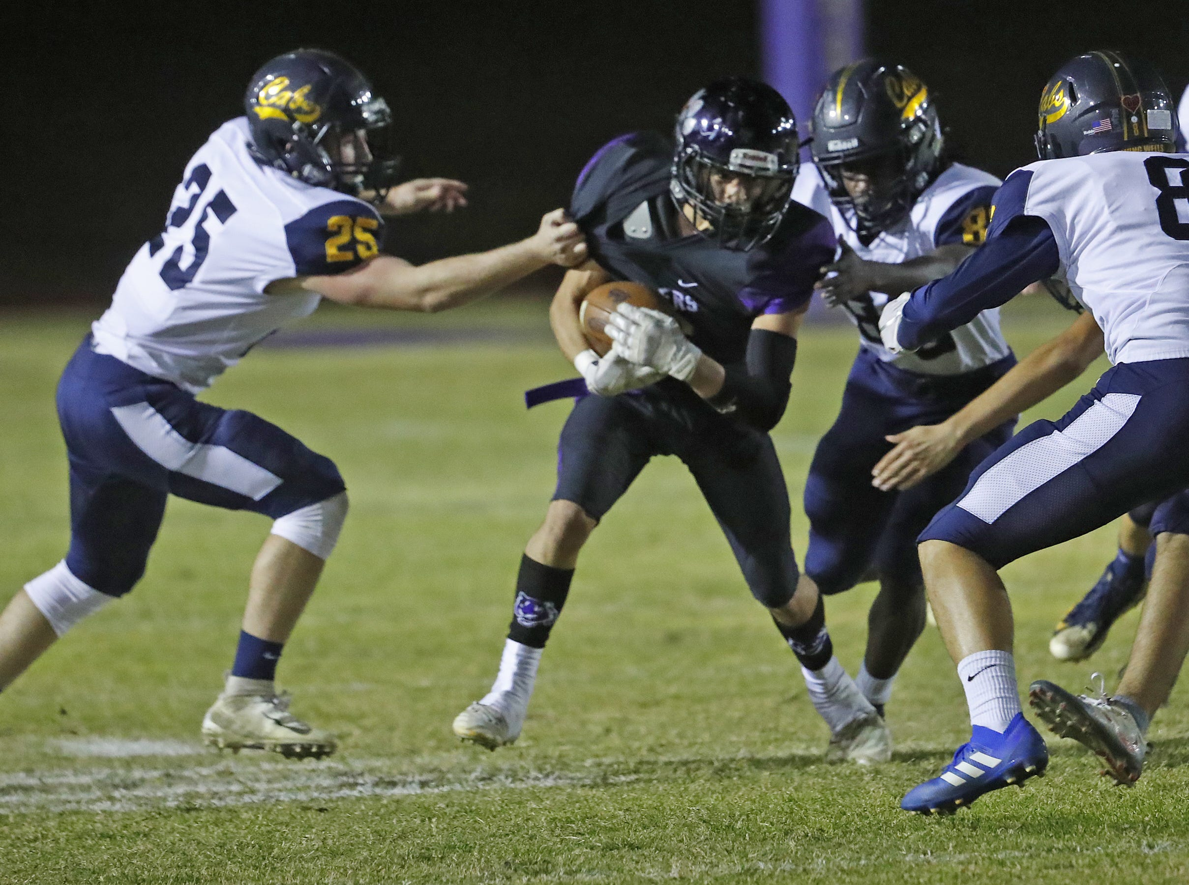 Millennium's Joseph Rosales (6) heads downfield against Flowing Wells' Blake Bishop (25) during the first round of the AIA State Football Playoffs at Millennium High School in Goodyear, Ariz. on November 2, 2018.