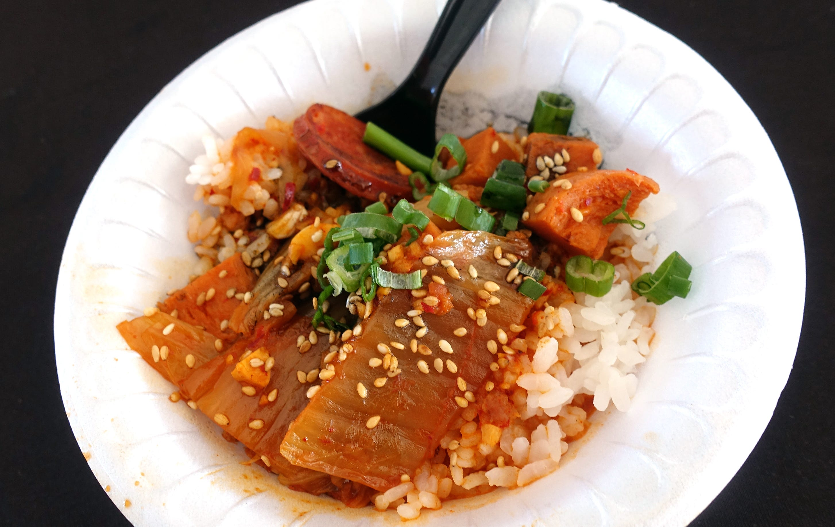 Budae-jjigae: Kimchi stew with andouille, kielbasa and spam from Obon Sushi + Bar + Ramen at azcentral Wine & Food Experience 2018 at WestWorld of Scottsdale, Saturday, Nov. 3, 2018.