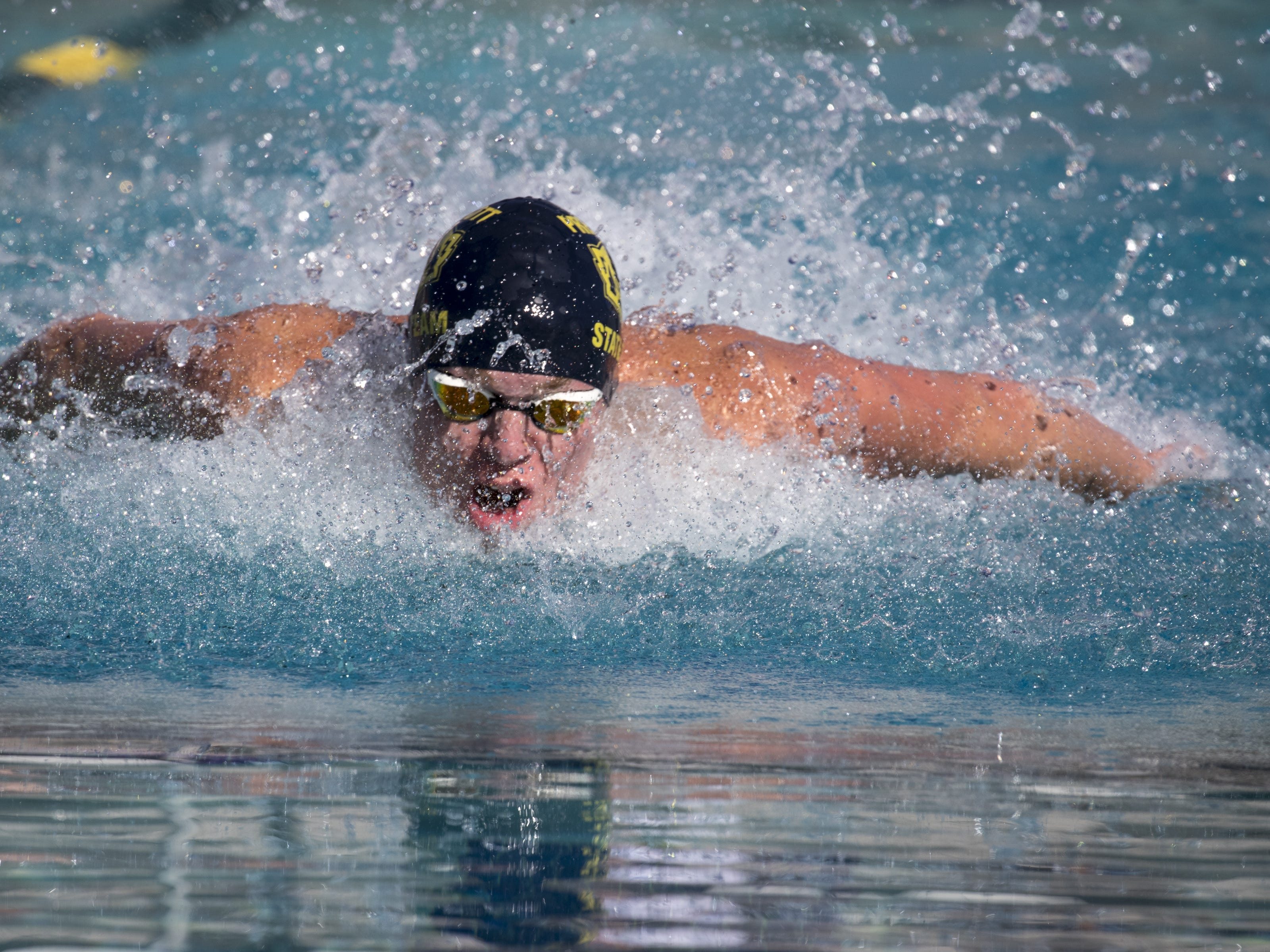 Harris Temple (Prescott) swims the 100 Butterfly, November 3, 2018, during the AIA Division II state swimming finals at the Skyline Aquatic Center, Mesa. Temple finished second.