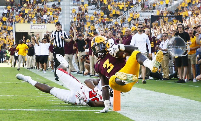Arizona State running back Eno Benjamin jumps into the end zone for a touchdown against Utah in the second half on Nov. 3 at Sun Devil Stadium.