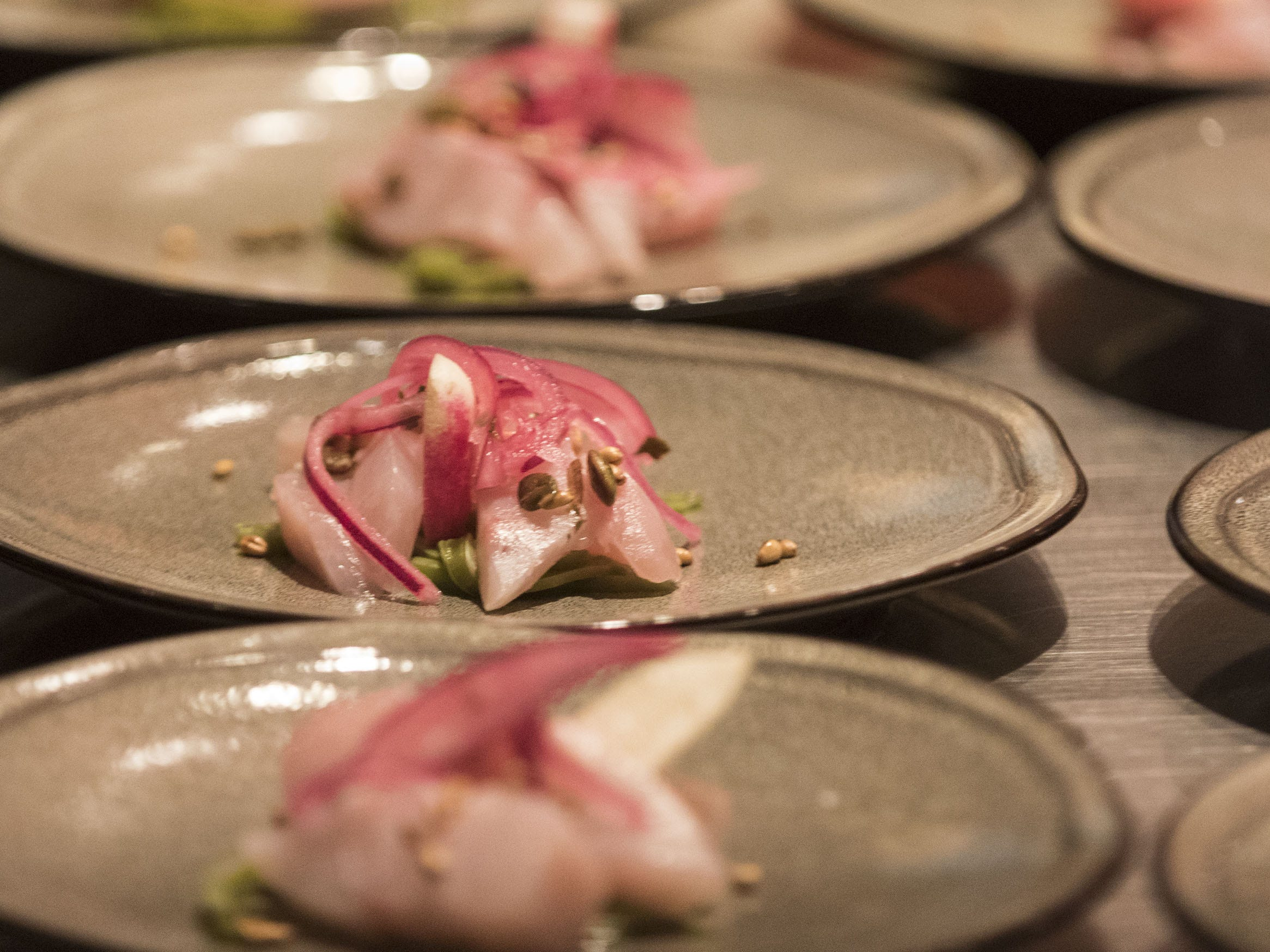 A plate of kampachi aguachile is ready to be served during the exclusive kickoff dining event at Mora Italian for azcentral Wine & Food Experience.