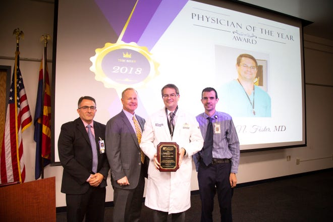 Dr. Kevin Foster receives the Physician of the Year Award from the Maricopa Integrated Health System in Phoenix, where he is the director of the Arizona Burn Center.