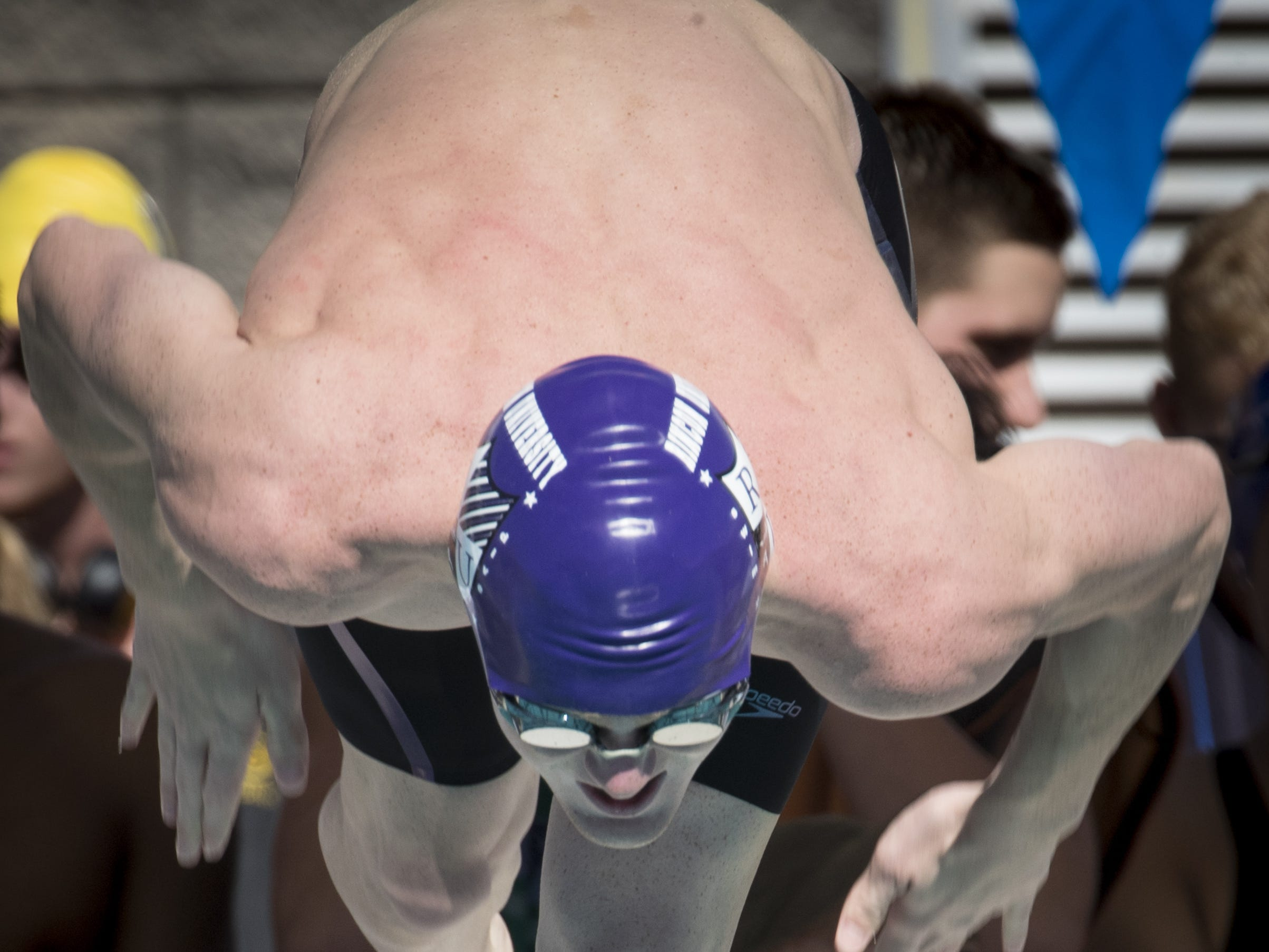 Keegan Kelaher (Rincon) leaves the blocks at the start of the 100 Breaststroke, November 3, 2018, during the AIA Division II state swimming finals at the Skyline Aquatic Center, Mesa. Kelaher finished third.