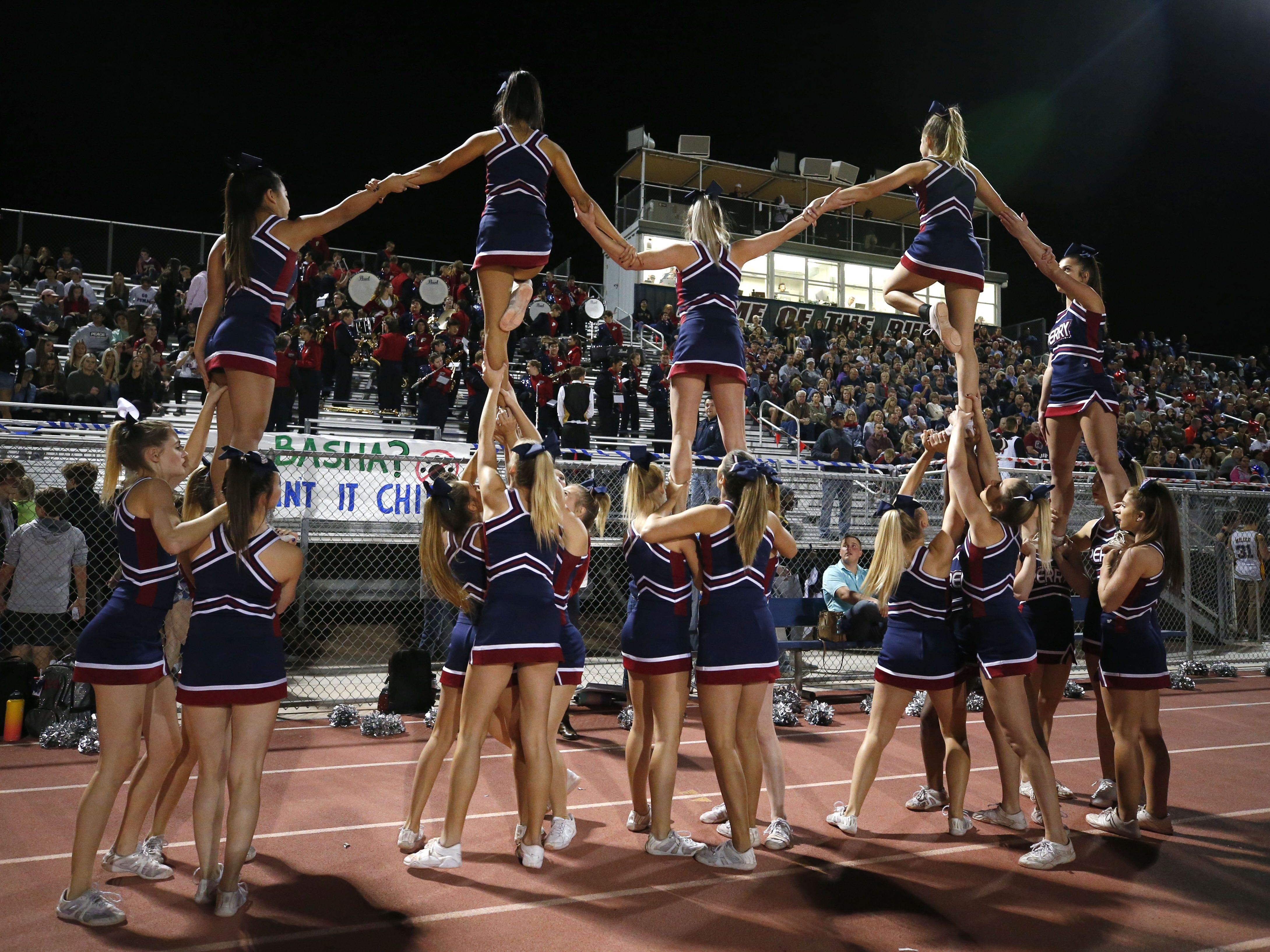 Perry cheerleaders perform a stunt during a football game against Basha at Perry High School on Nov. 2. #azhsfb