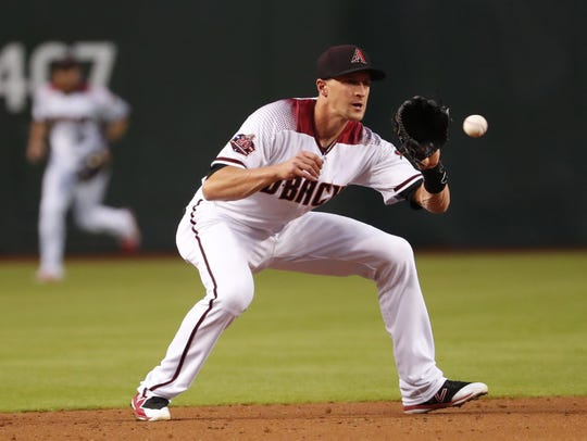 Diamondbacks shortstop Nick Ahmed fields a ground ball at Chase Field in May.