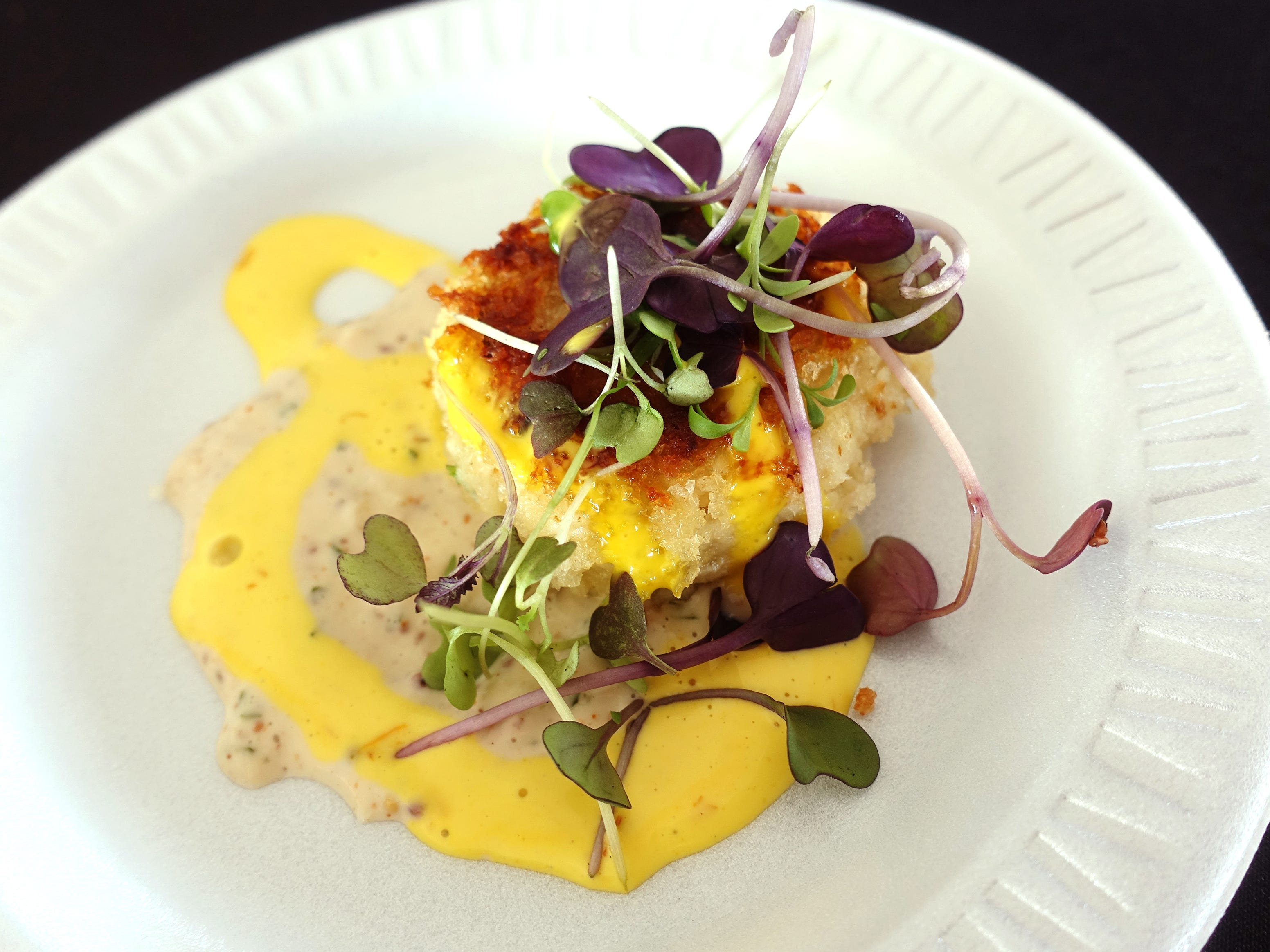 Maryland-style crab cake with roasted onion remoulade and saffron aioli from Timo Wine Bar at azcentral Wine & Food Experience 2018 at WestWorld of Scottsdale, Saturday, Nov. 3, 2018.