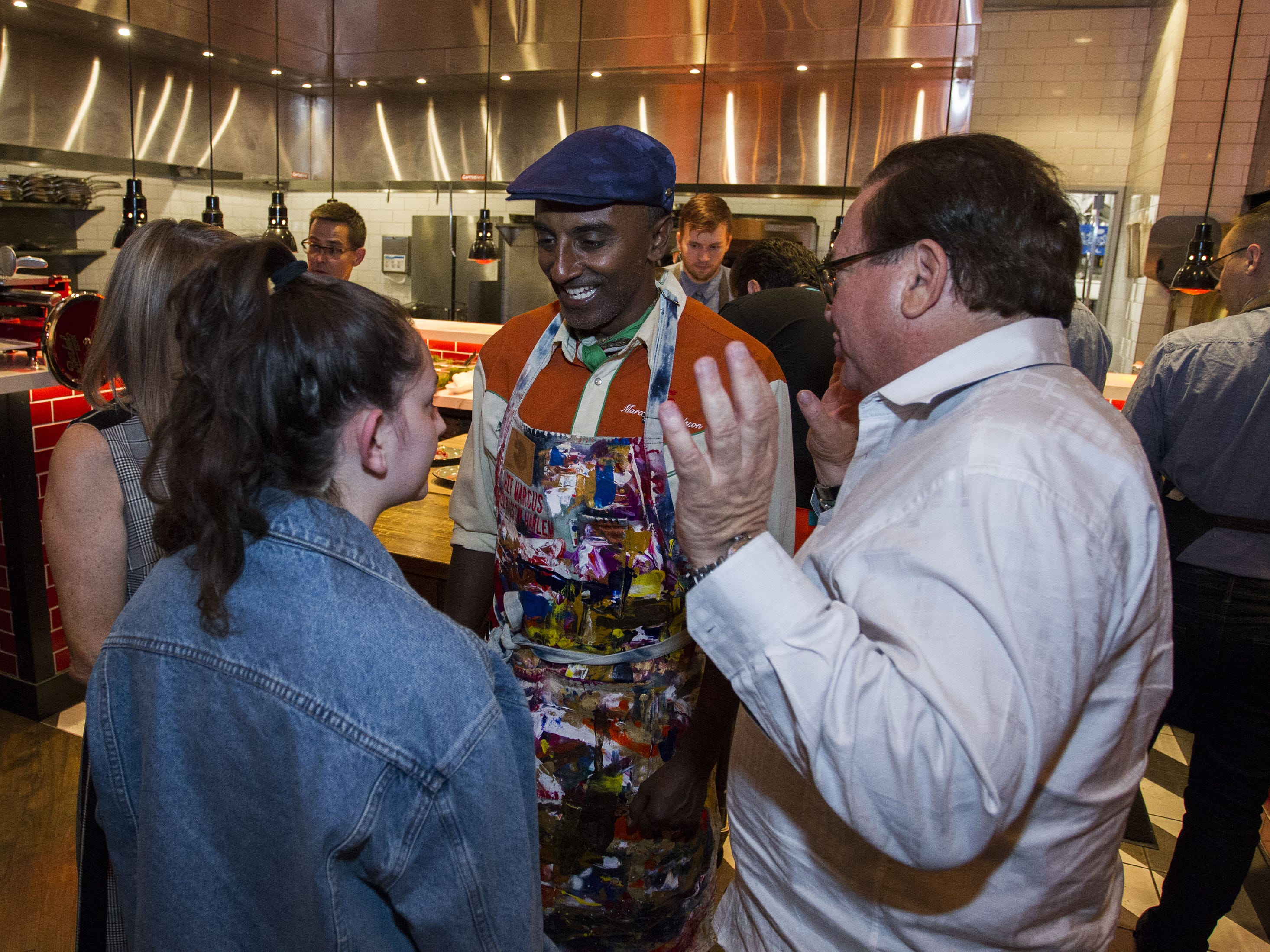 Chef Marcus Samuelsson greets guests during the exclusive kickoff dining event at Mora Italian for azcentral Wine & Food Experience.