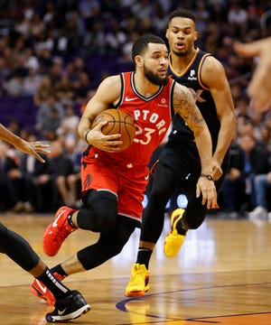 Toronto Raptors guard Fred VanVleet (23) drives against the Phoenix Suns during the first half of an NBA basketball game, Friday, Nov. 2, 2018, in Phoenix.