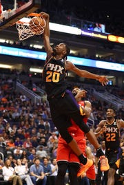 Suns forward Josh Jackson dunks the ball during the fourth quarter of a game against the Raptors.