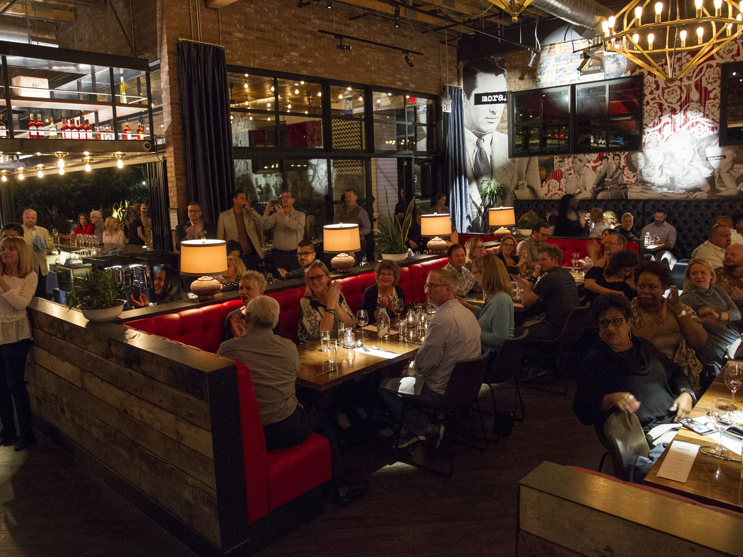 Diners enjoy food and friends during the exclusive kickoff dining event at Mora Italian for azcentral Wine & Food Experience featuring chefs Scott Conant and Marcus Samuelsson.