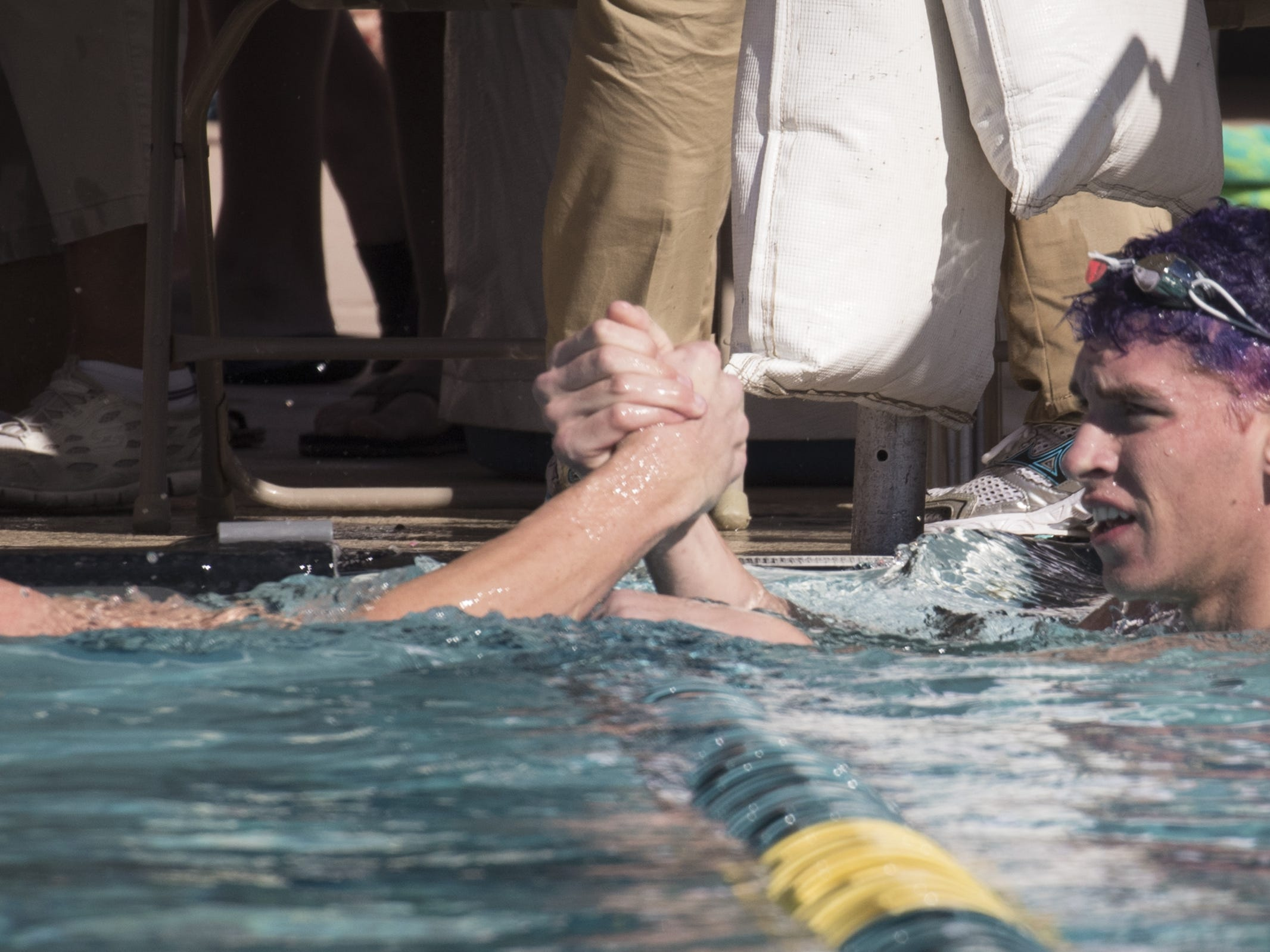 Drake Barberie (Rincon, right) is congratulated by Harris Temple (Prescott) after he won the 100 Butterfly, November 3, 2018, during the AIA Division II state swimming finals at the Skyline Aquatic Center, Mesa.