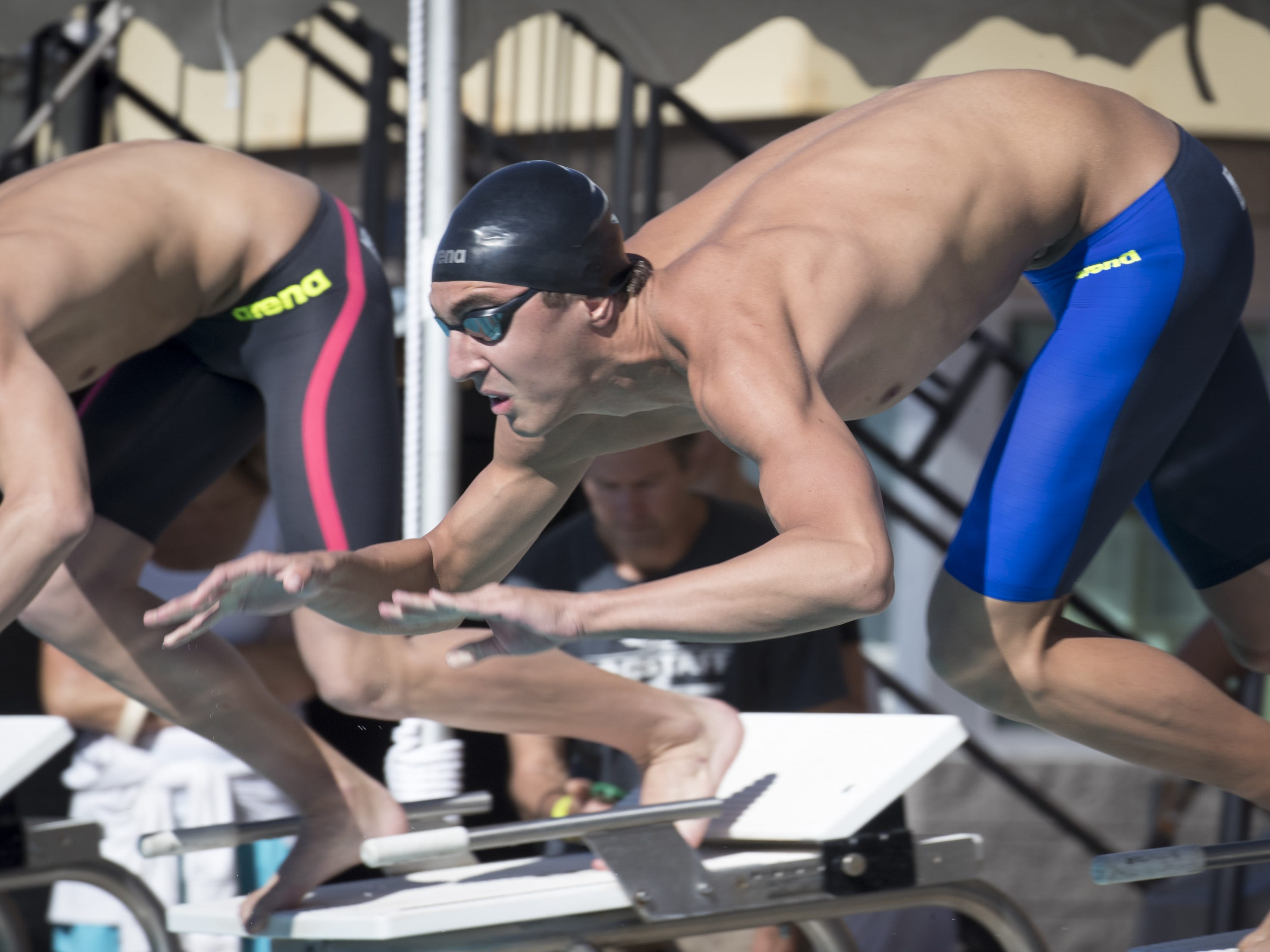 Jered Moore (Cactus Shadows) leaves the blocks at the start of the 100 Freestyle, November 3, 2018, during the AIA Division II state swimming finals at the Skyline Aquatic Center, Mesa. Moore won the event.