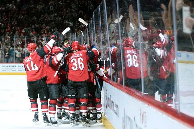 Nov 2, 2018: Arizona Coyotes players celebrate after defeating the Carolina Hurricanes at Gila River Arena.