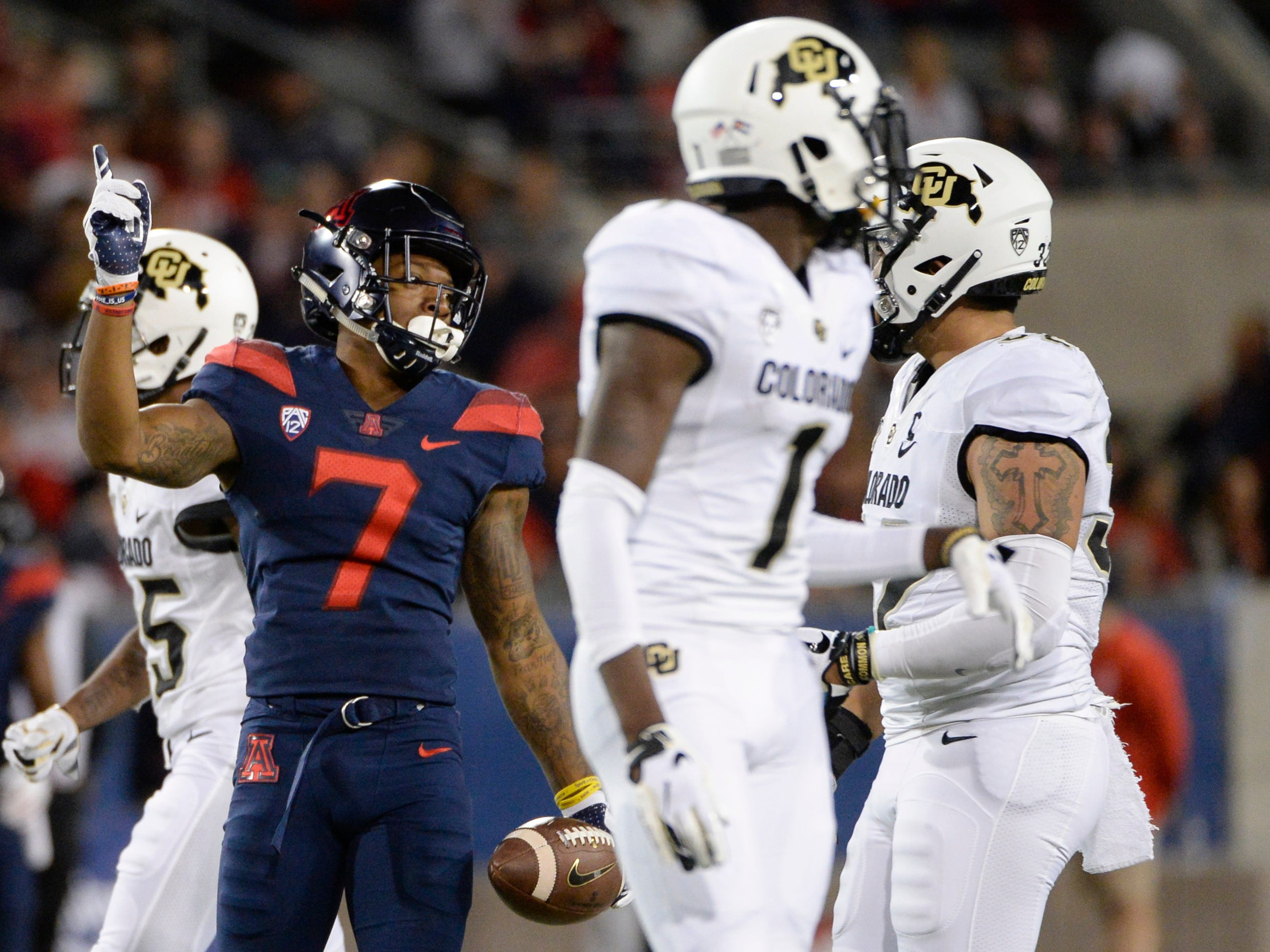 Nov 2, 2018; Tucson, AZ, USA; Arizona Wildcats wide receiver Devaughn Cooper (7) celebrates after making a catch against the Colorado Buffaloes during the first half at Arizona Stadium.