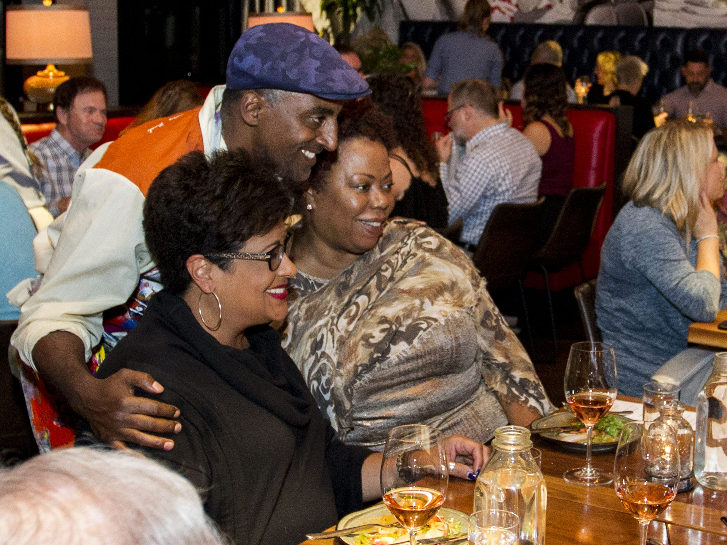 Chef Marcus Samuelsson poses with Julie Rideau and Jean Miller-Aikens during the exclusive kickoff dining event at Mora Italian for azcentral Wine & Food Experience.