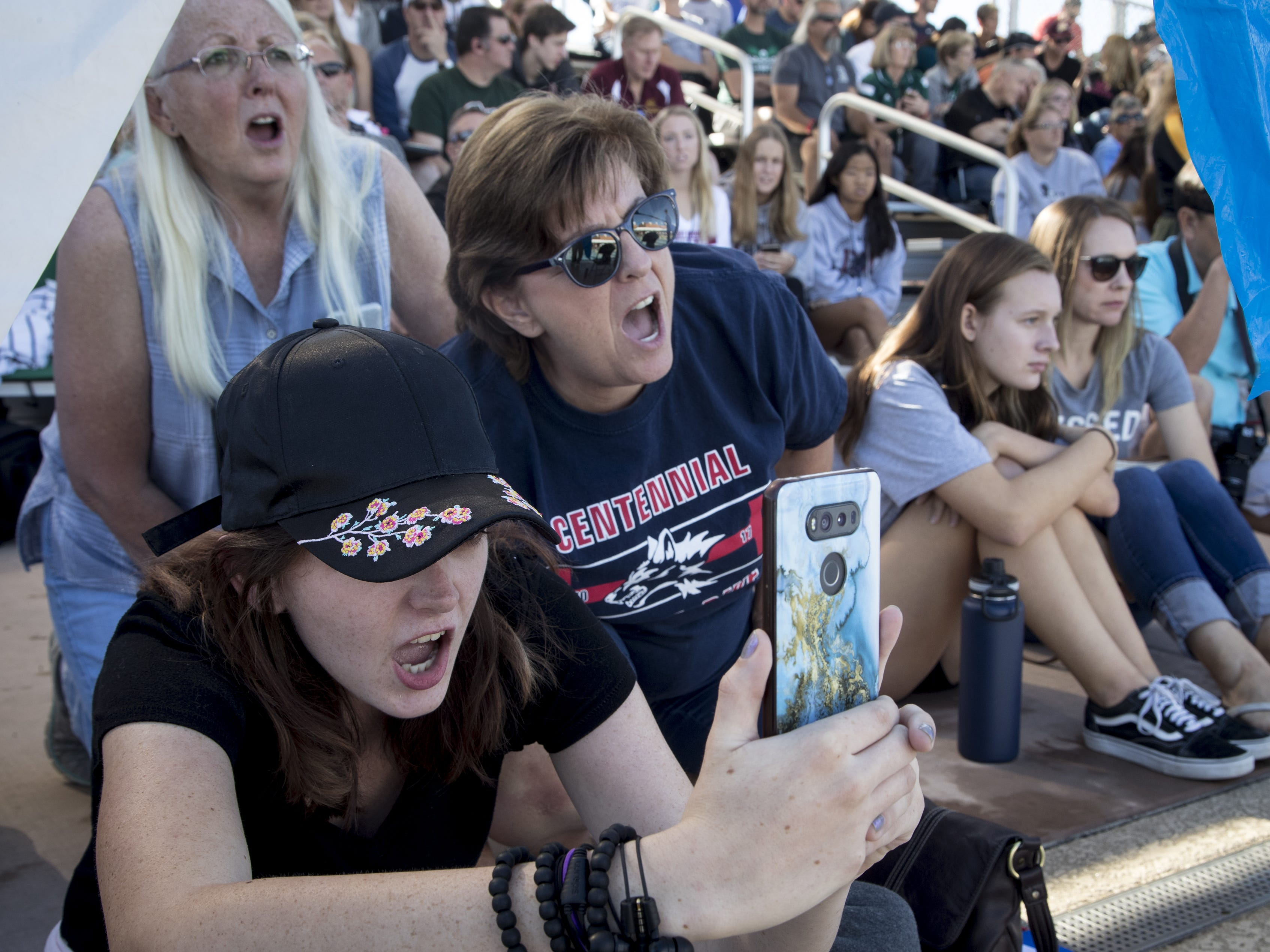Spectators cheer, November 3, 2018, during the AIA Division II state swimming finals at the Skyline Aquatic Center, Mesa.