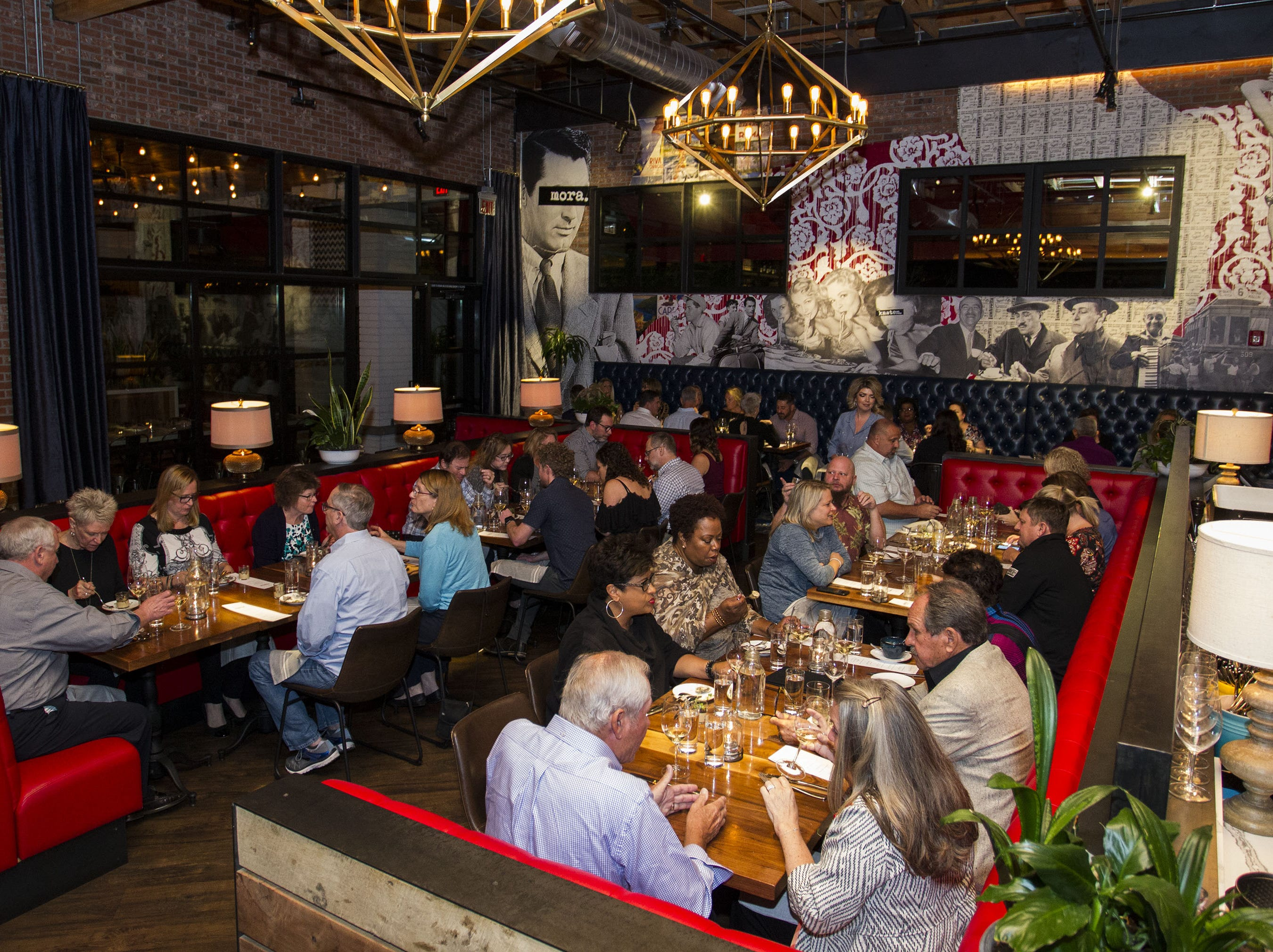 Diners enjoy food and friends during the exclusive kickoff dining event at Mora Italian for azcentral Wine & Food Experience.